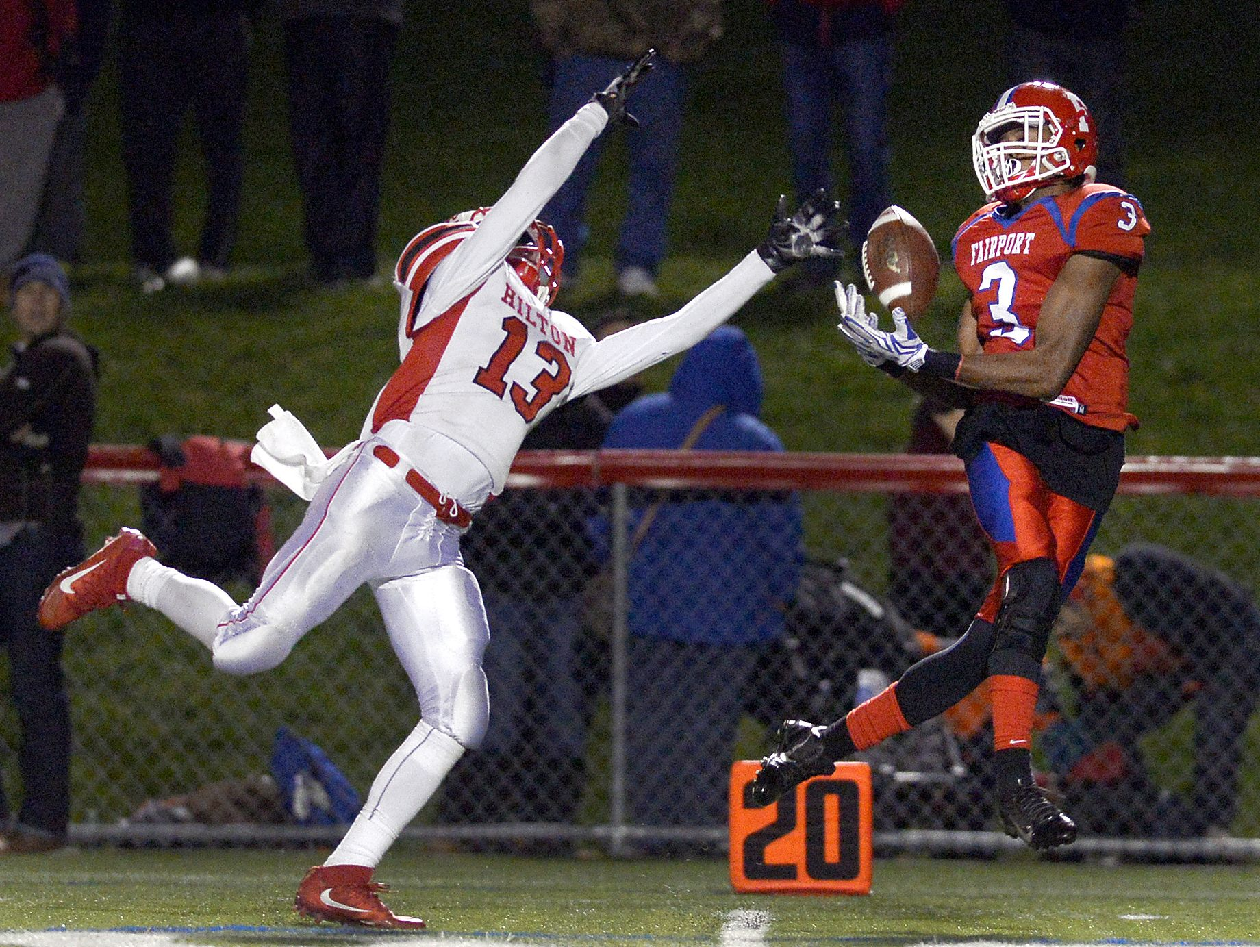 Fairport's Beeshawn Curry, right, tries to haul in this pass while being defended by Hilton's Joseph Sach during a regular-season game. The third-seeded Red Raiders face No. 3 Pittsford in the Section V Class AA semifinals at 4 p.m. Sunday at Rhinos Stadium.
