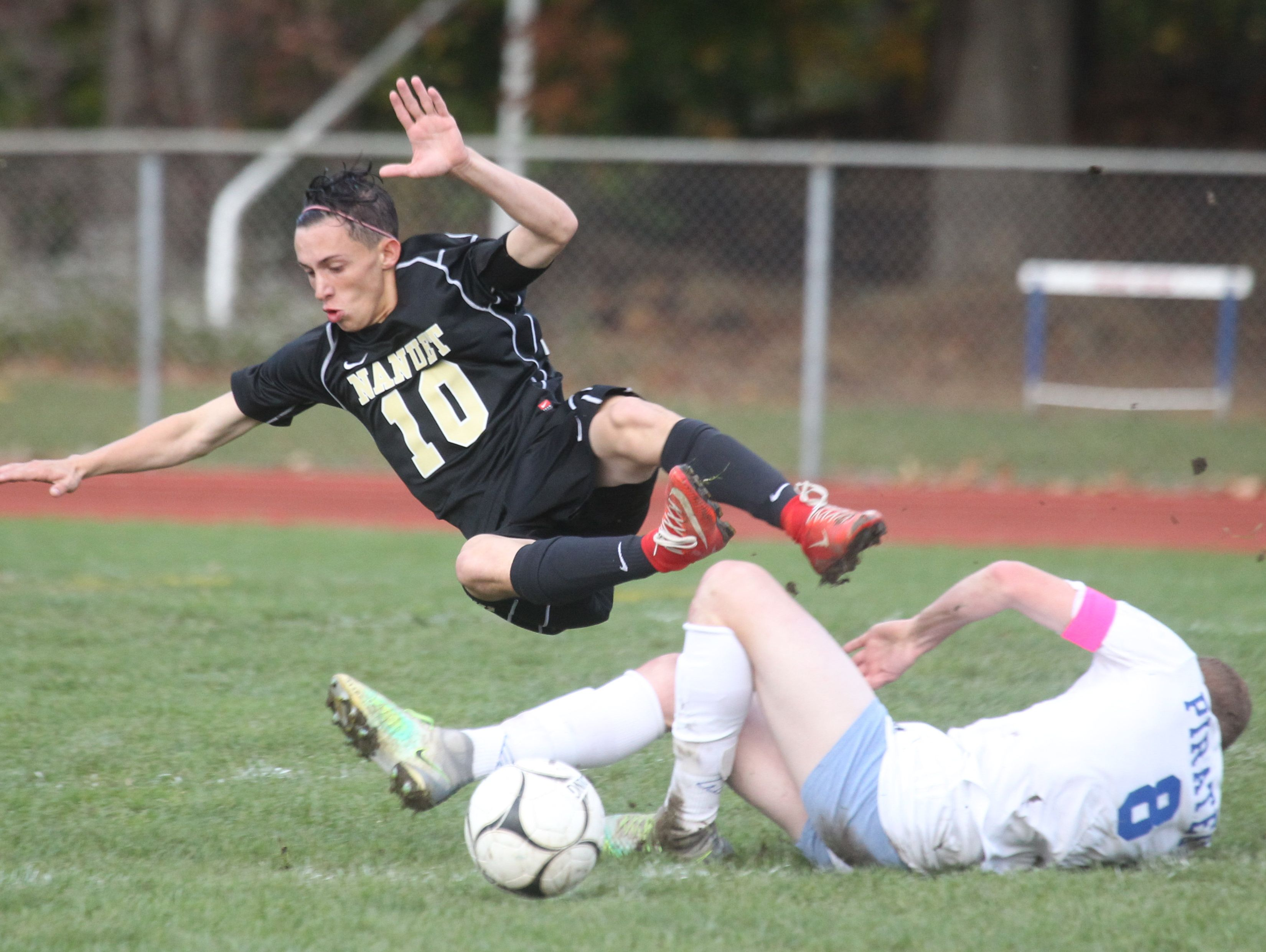 Nanuet's Nick Iozzo flies over Pearl River's Timmy Valentine during their Class A boys soccer quarterfinal at Pear River Oct. 24, 2016. Pearl River won 2-1 in overtime.