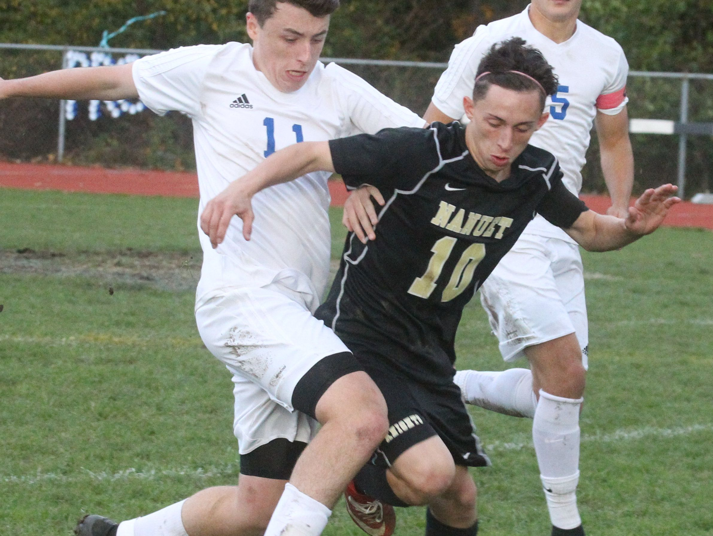 Pearl River's Dara Donnelly, left, fights for the ball with Nanuet's Nick Iozzo during their Class A boys soccer quarterfinal at Pear River Oct. 24, 2016. Pearl River won 2-1 in overtime. 6 23