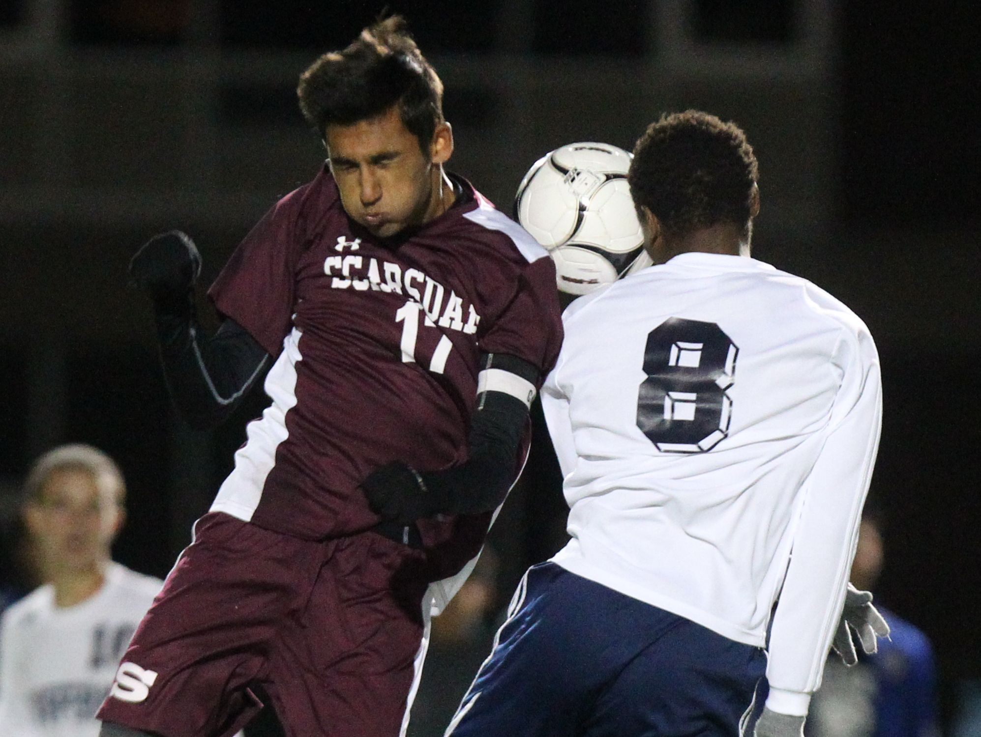 Scarsdale's Fayez Merchant, left, goes up for the ball with Suffern's Harrison Dranoff during their Class AA boys soccer quarterfinal at Suffern Oct. 24, 2016.