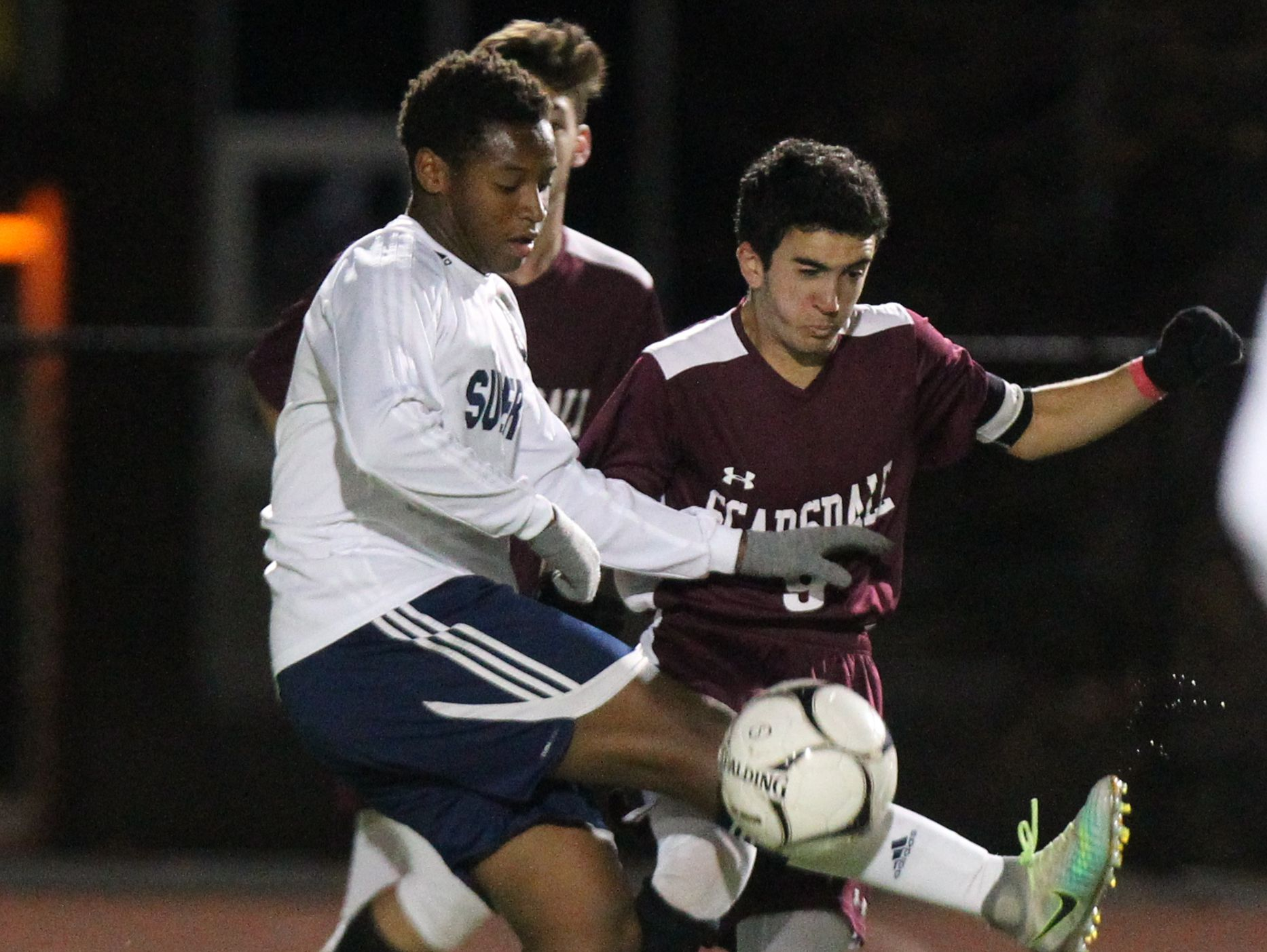 Suffern's Harrison Dranoff, left, is pressured by Scarsdale's Michael Spiro during their Class AA boys soccer quarterfinal at Suffern Oct. 24, 2016.