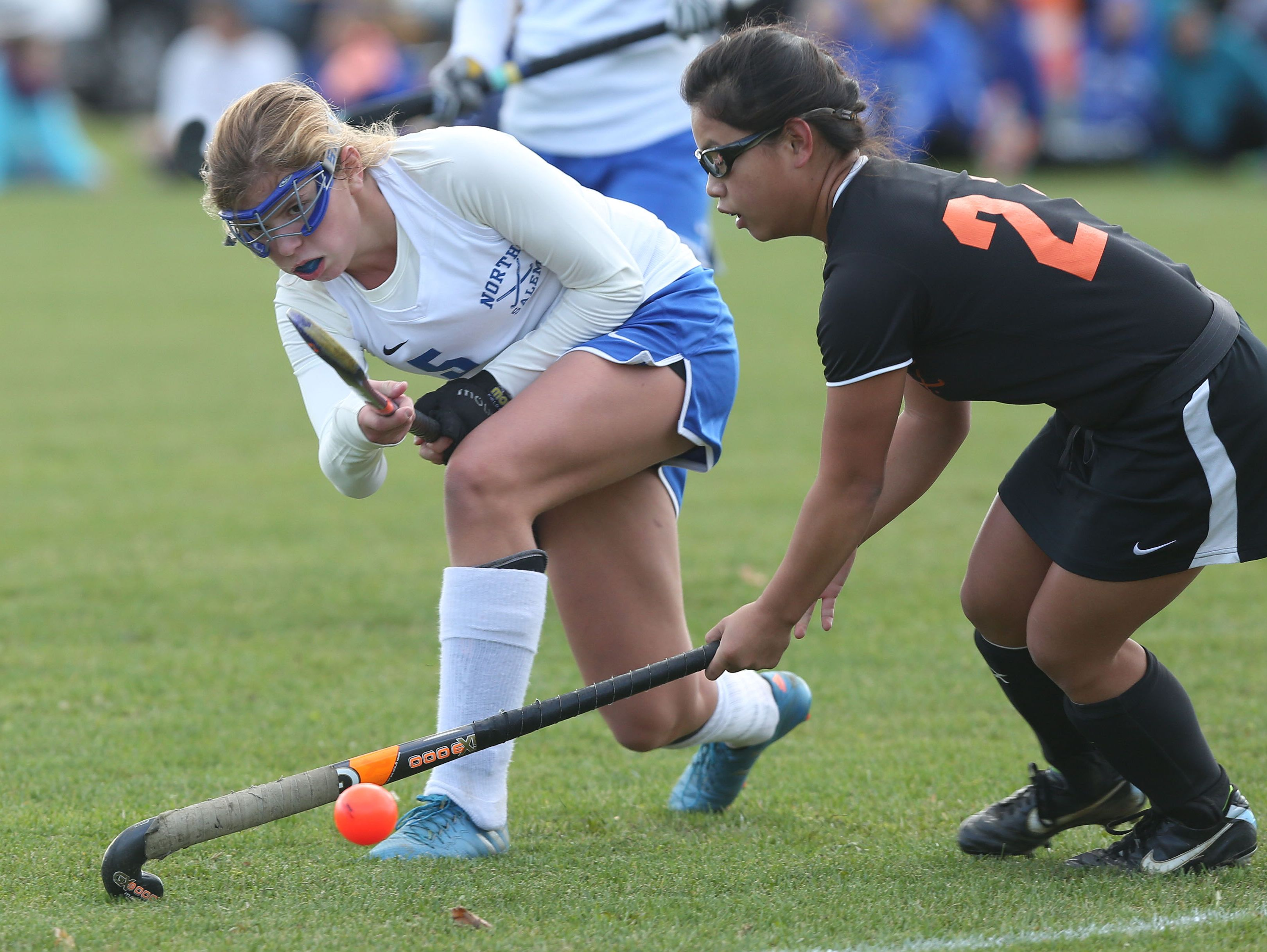 From left, North Salem's Allison Eberhardt (15) moves the ball away from Pawling's Carly McGrath (21) during field hockey action at North Salem High School Oct. 25, 2016. North Salem won the game 1-0.