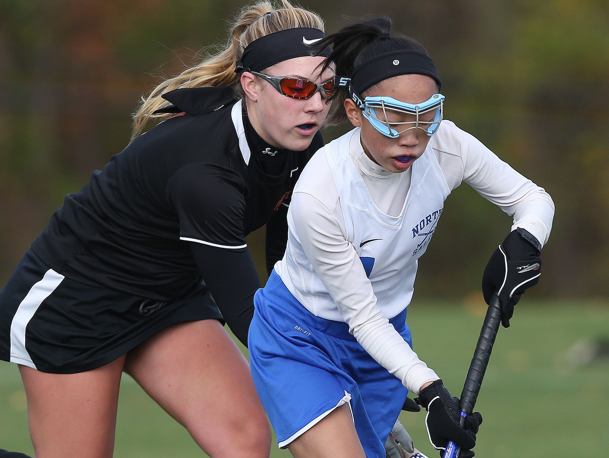 North Salem's Mariana Alpizar (11) moves the ball away from Pawling's Courtney Adams (1) during field hockey action at North Salem High School Oct. 25, 2016. North Salem won the game 1-0.