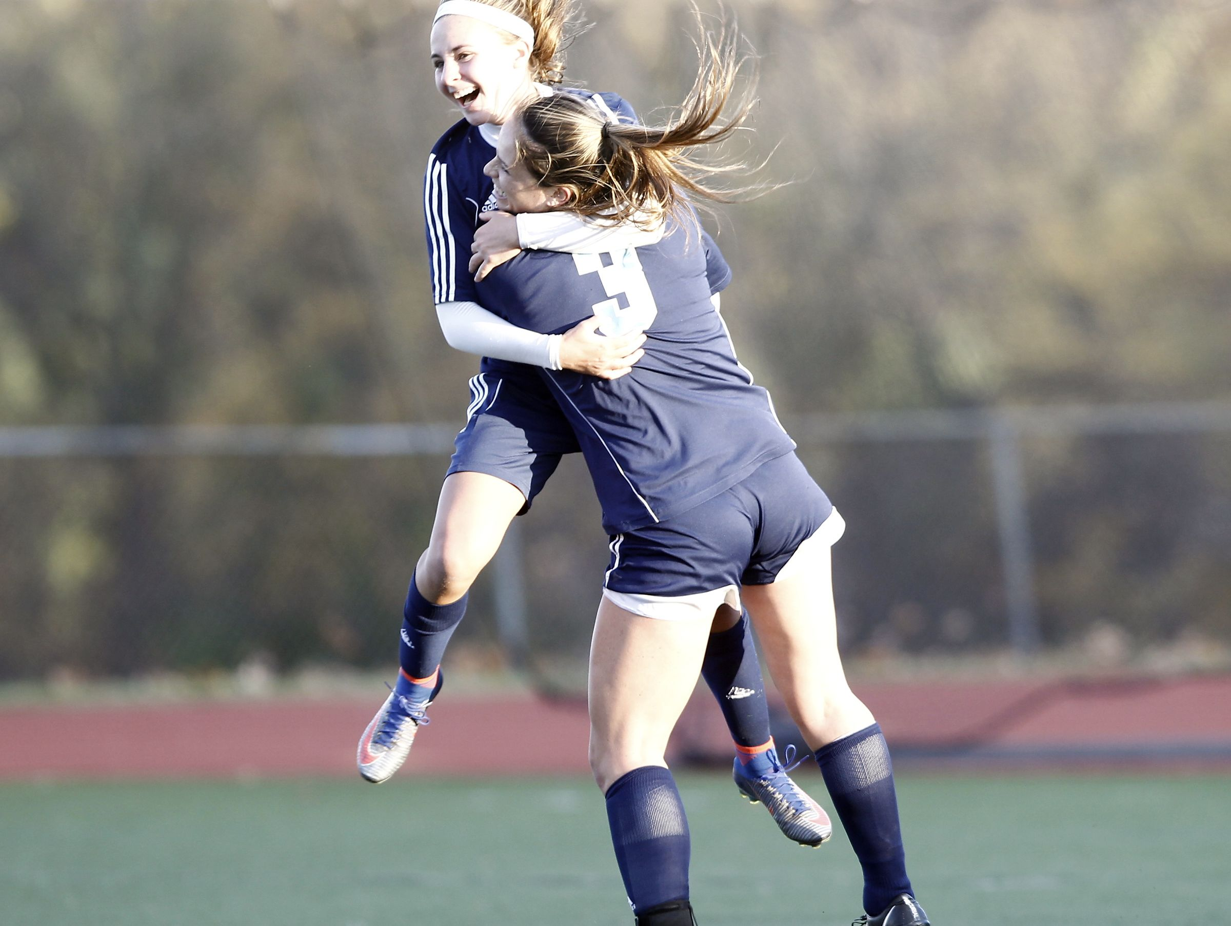 Suffern's Kailey Brenner (4) left, and Kyra Brenner (3) celebrate a goal during girls Class AA soccer quarterfinal at Clarkstown High School South in West Nyack on Tuesday, October 25, 2016.