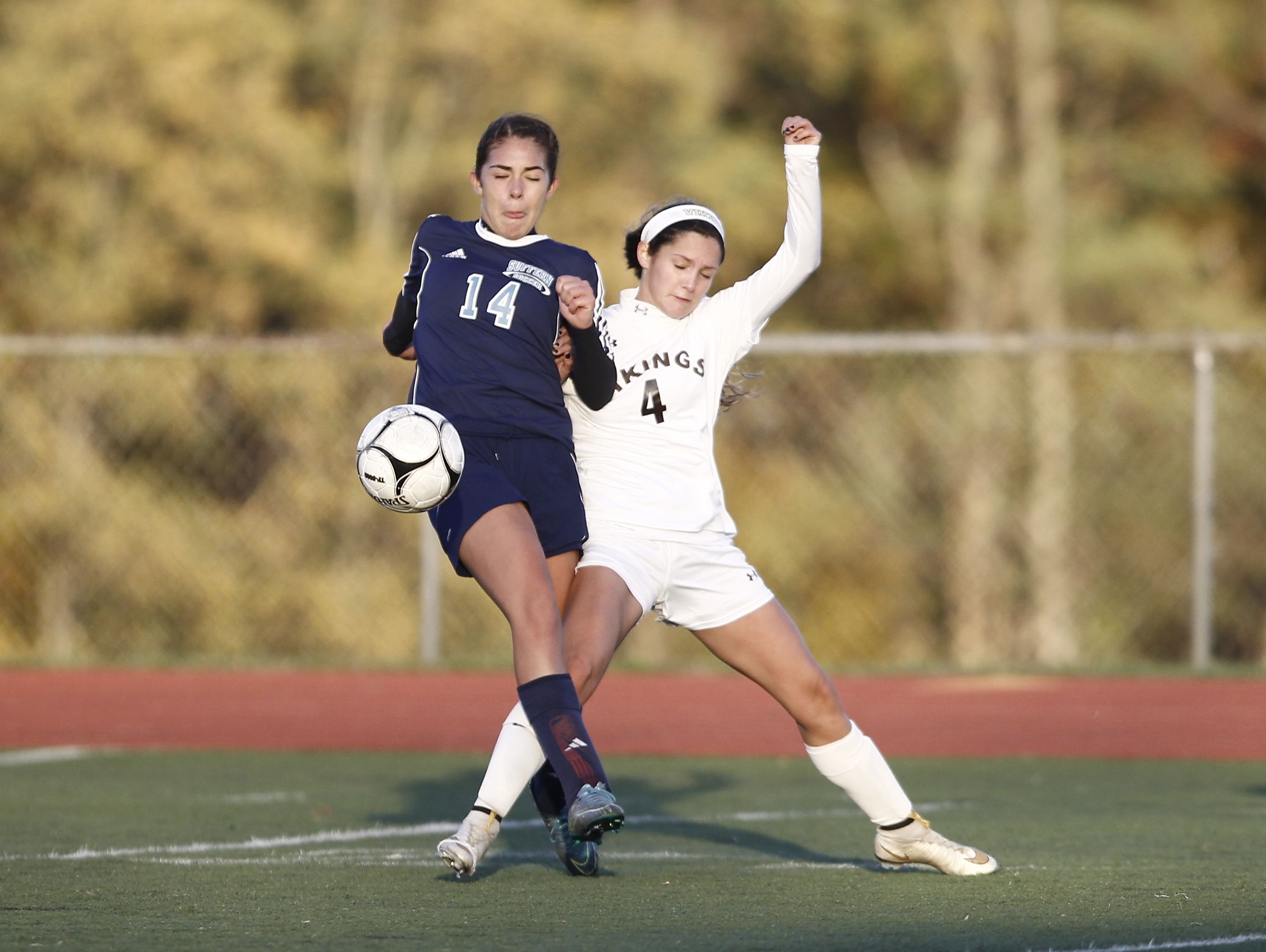 Suffern's Tatiana Cruz (14) and Clarkstown South's Fiona Cummings (4) battle for possession during girls Class AA soccer quarterfinal at Clarkstown High School South in West Nyack on Tuesday, October 25, 2016. Suffern advances with their 2-0 win.