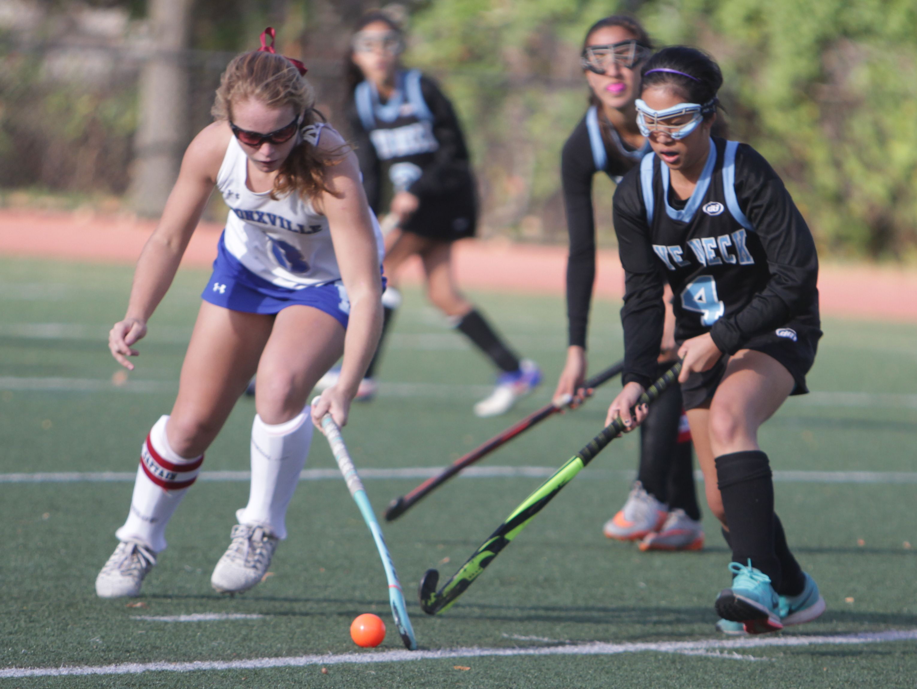 Bronxville's Ellie Walsh and Rye Neck's Catherine Yoo battle for possession of the ball during a Section 1, Class C field hockey game at Bronxville High School on Tuesday, Oct. 25th, 2016.
