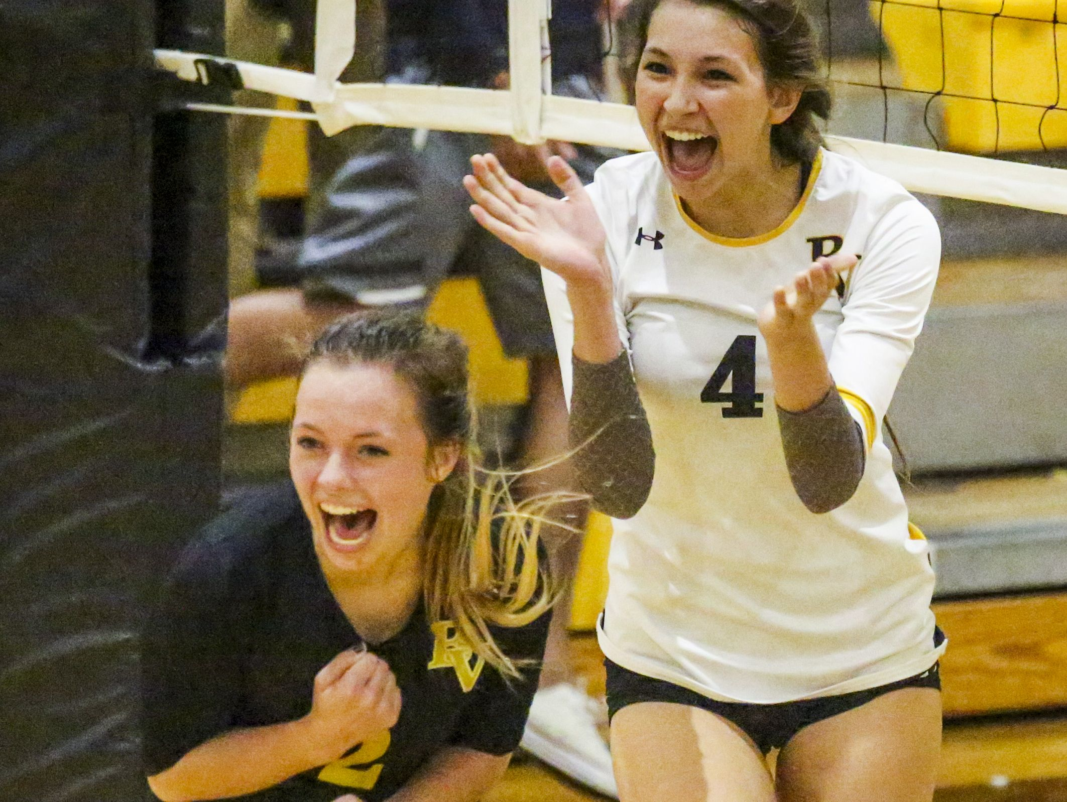 Bishop Verot players Mindie Mabry and Kelsey Sullivan celebrate a point asTampa Academy of Holy Names played Bishop Verot in their Region 5A-3 volleyball quarterfinal.