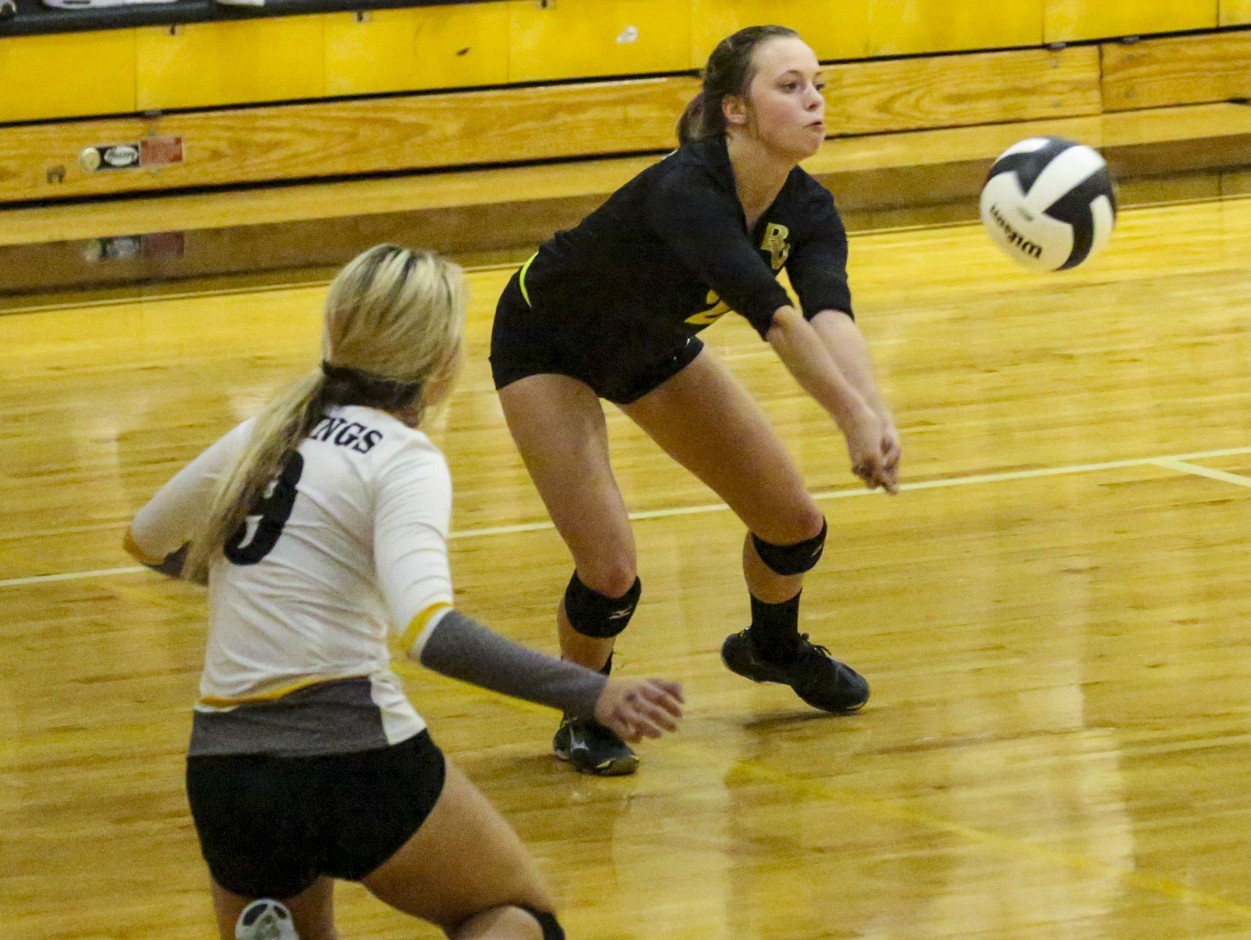 Bishop Verot's Kelsey Sullivan digs the ball in the back row. Tampa Academy of Holy Names played Bishop Verot in their Region 5A-3 volleyball quarterfinal.