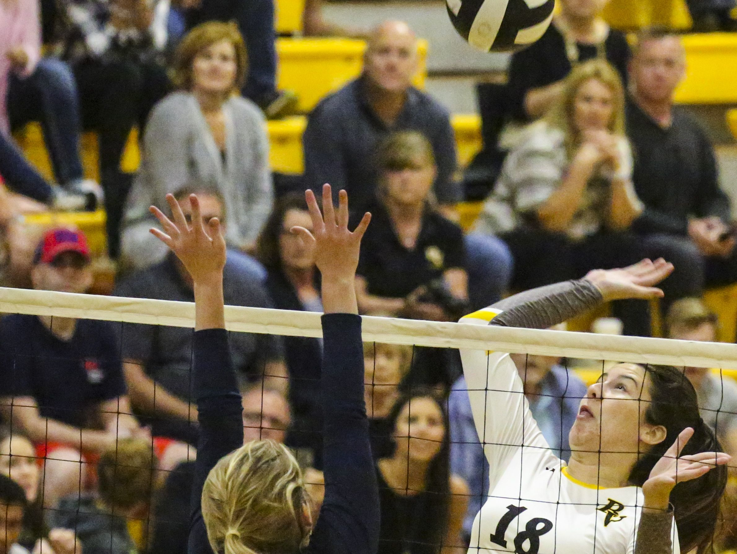 Bishop Verot's Margaux Fry hits on Holly Names' Kendall Bulleit as Tampa Academy of Holy Names played Bishop Verot in their Region 5A-3 volleyball quarterfinal.