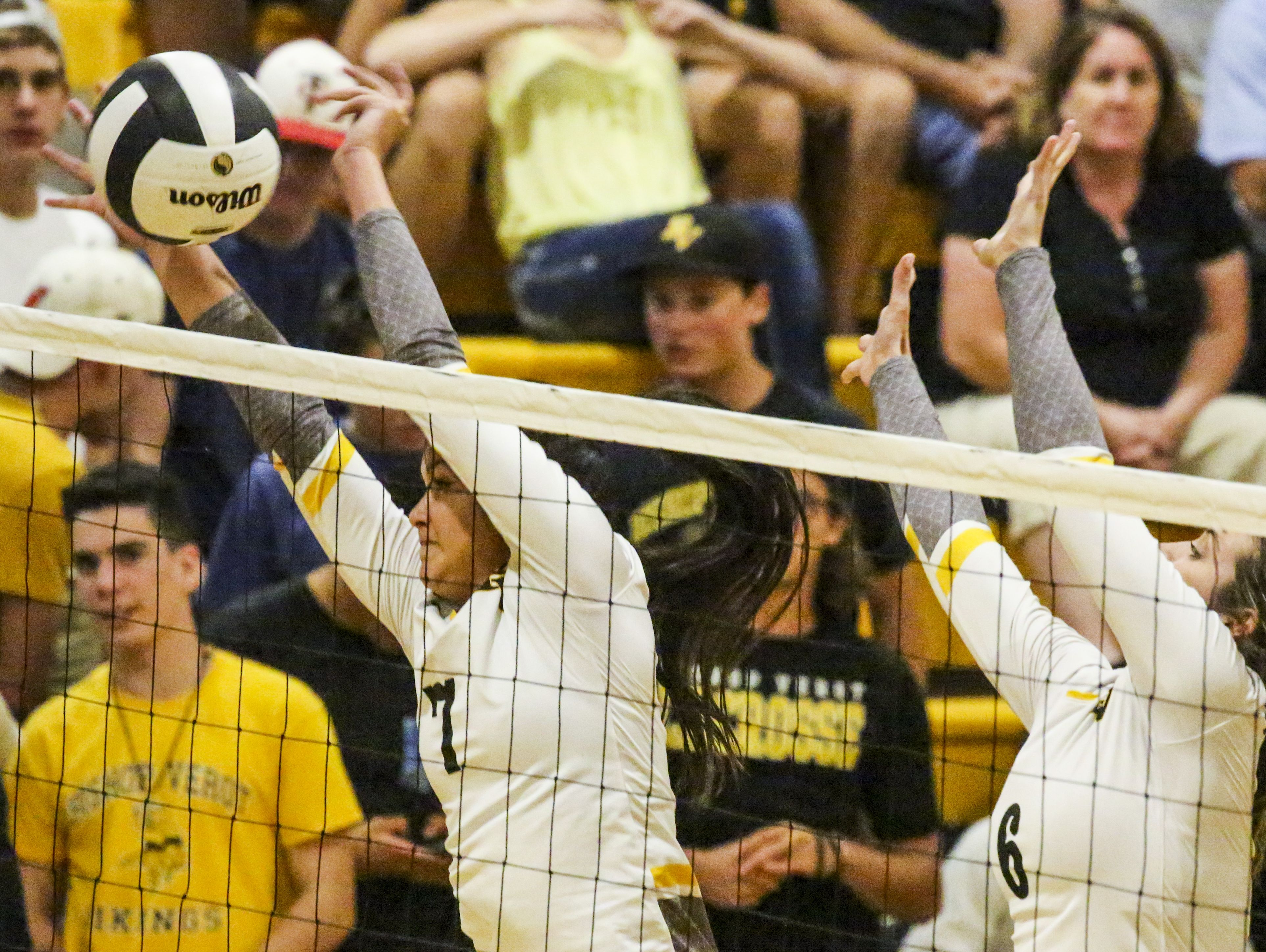 Bishop Verot blockers, Teya Leonard stuffs the ball with teammate, Melissa Becker. Tampa Academy of Holy Names played Bishop Verot in their Region 5A-3 volleyball quarterfinal.
