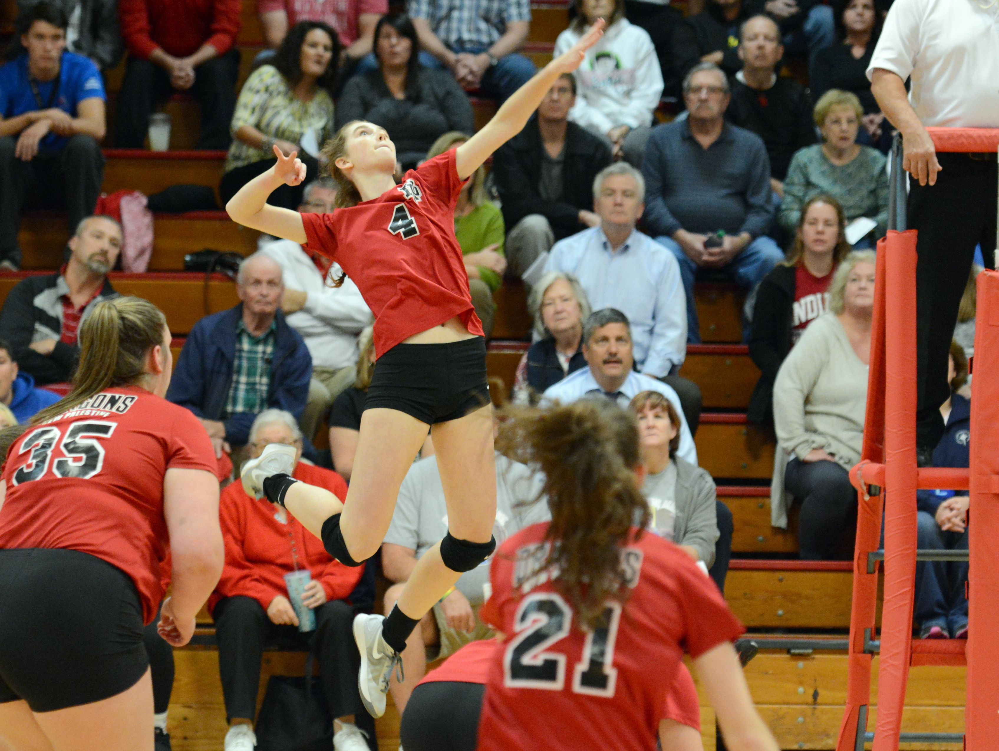 Allison Dennemann of New Palestine competes against Cardinal Ritter in a volleyball regional.