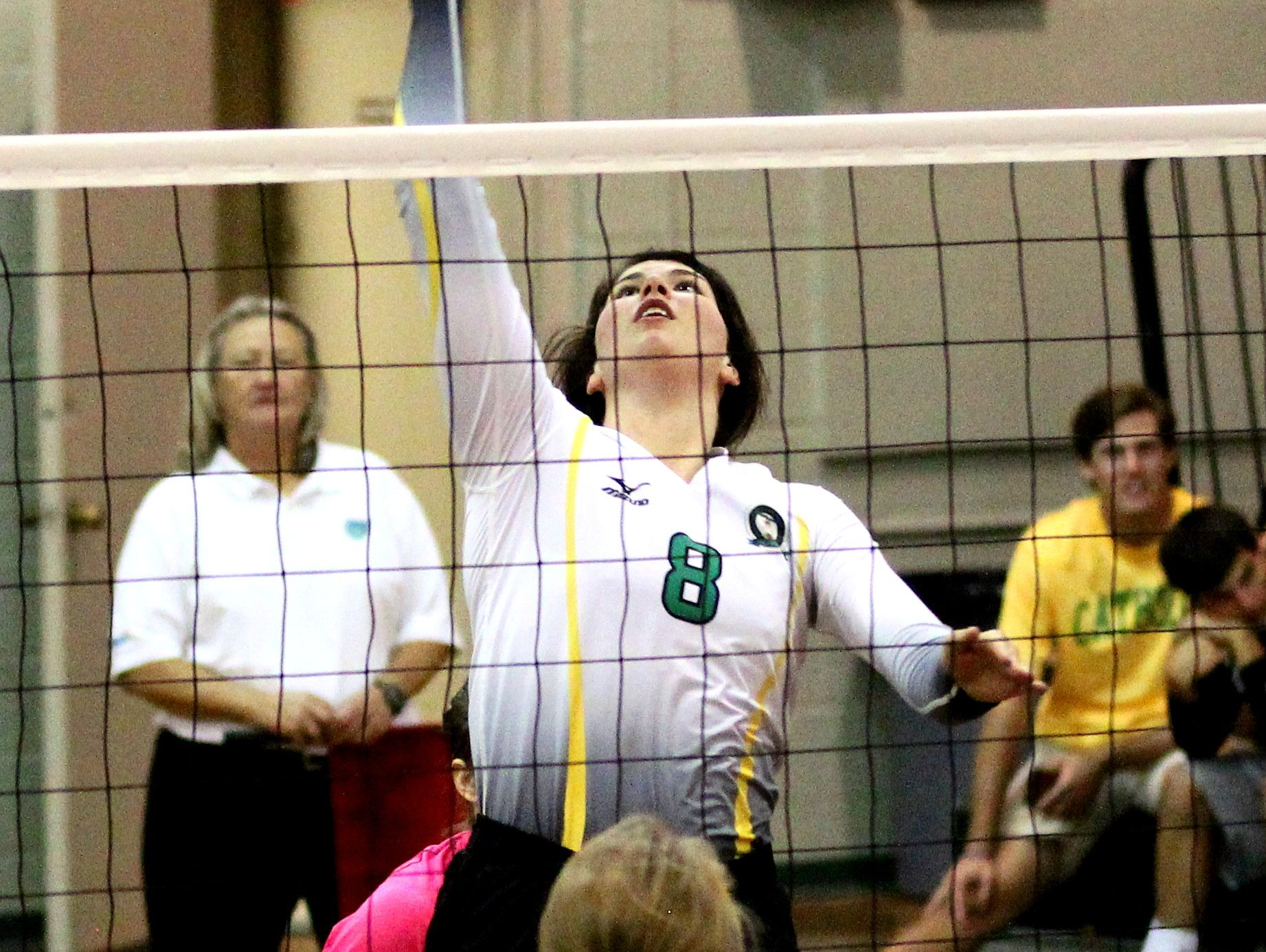 Catholic's Payton Goff sends the ball back over the net.