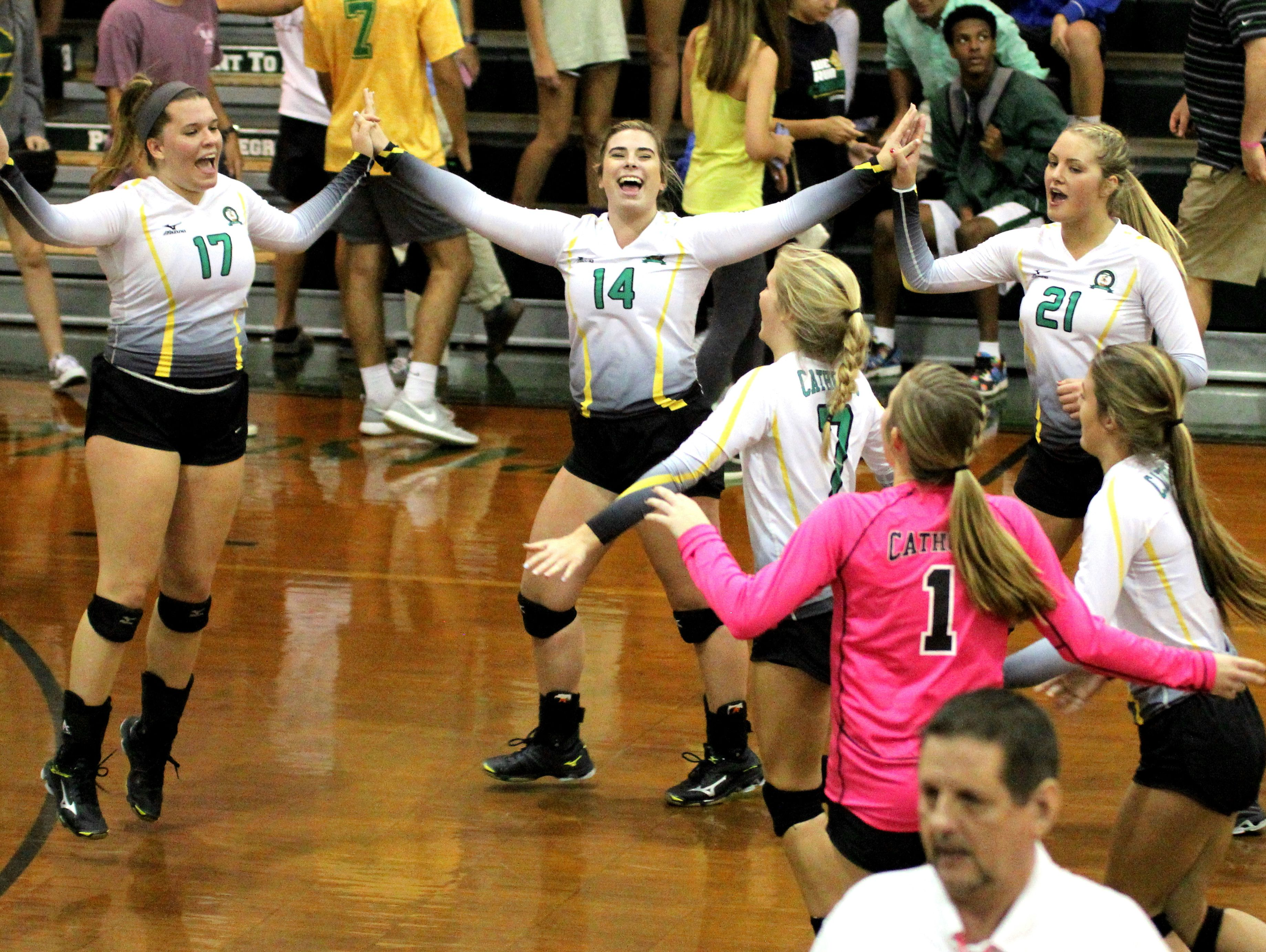 Catholic High players celebrate after the team pulls off the Region 1-5A win over Marianna on Tuesday.