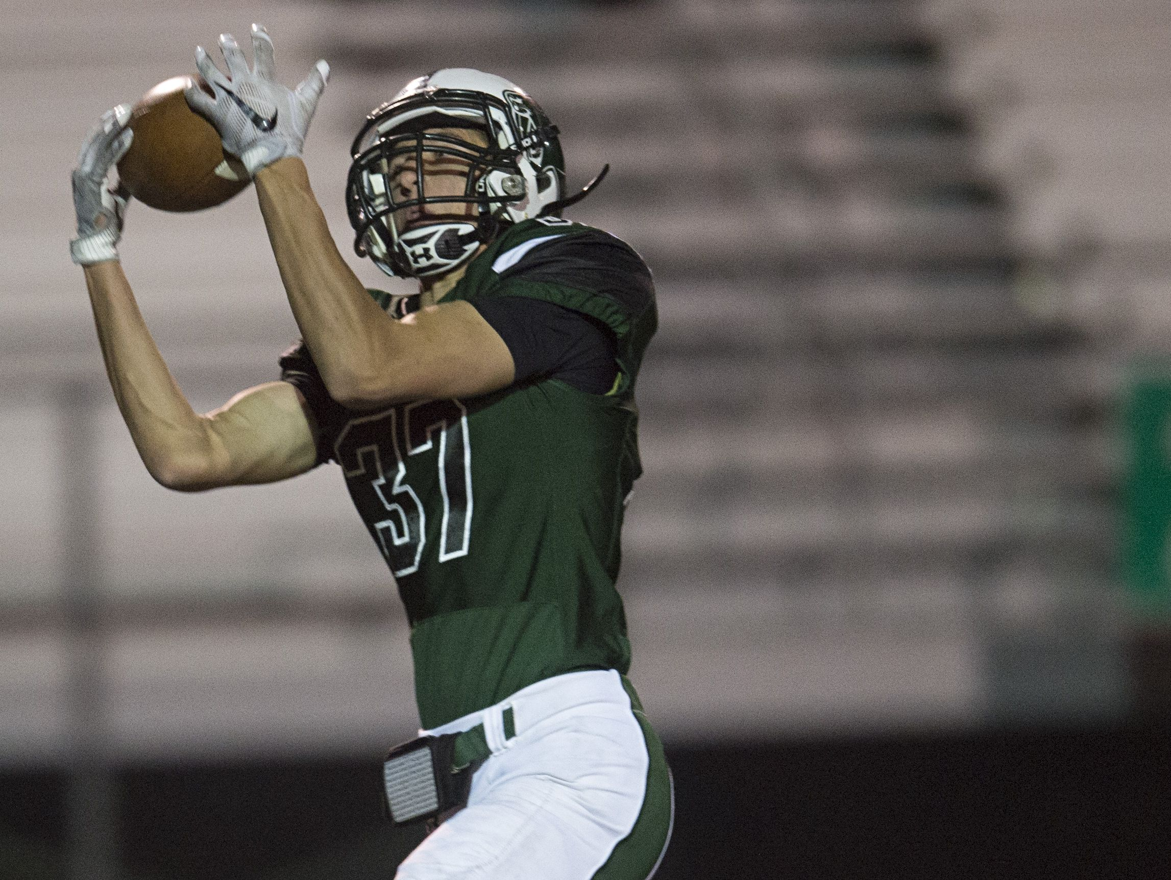 Fossil Ridge wide receiver Donovan Murphree catches the ball for a touchdown during a game against Denver East last week. The SaberCats host Far Northeast on Thursday.