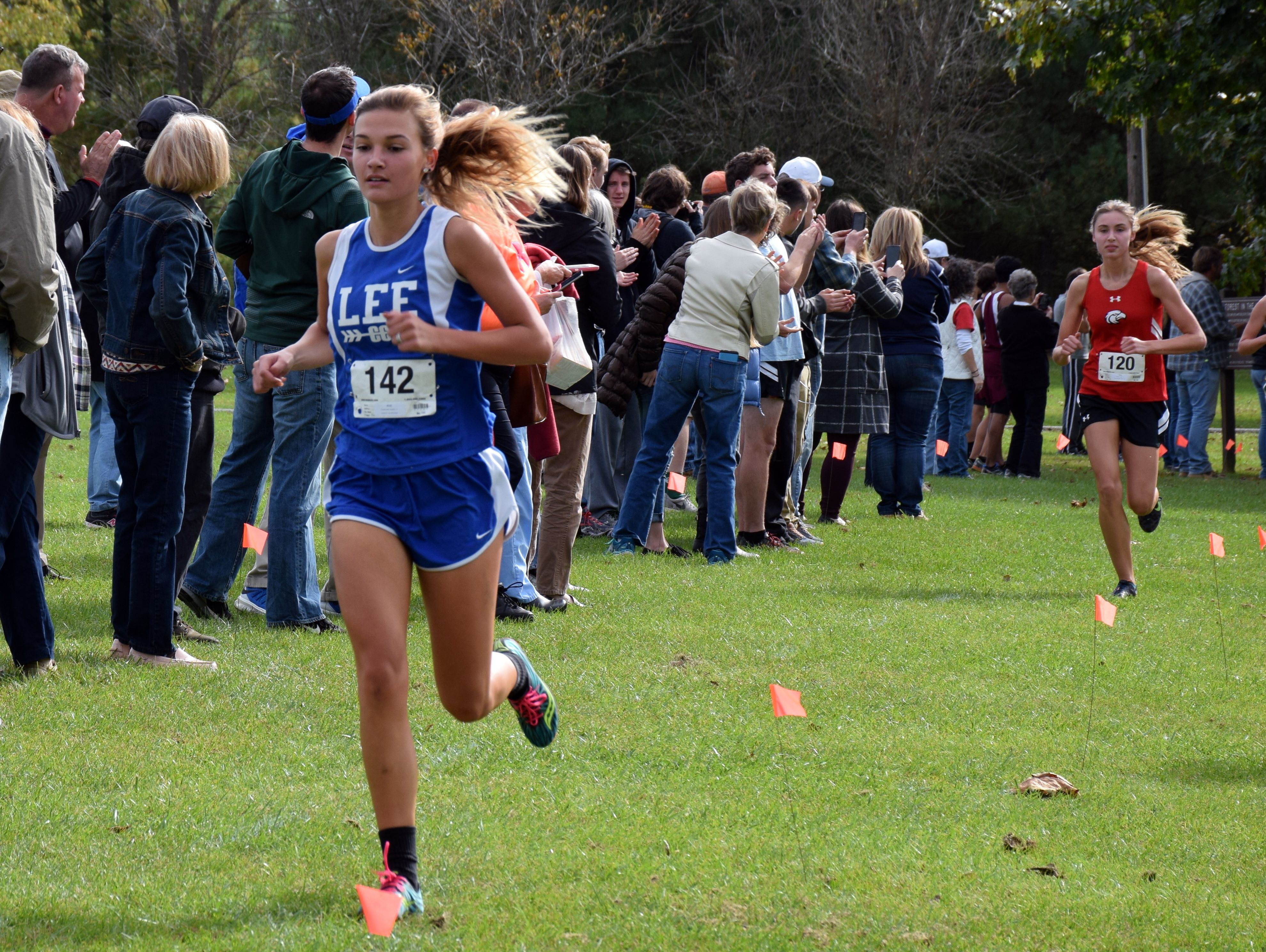 Robert E. Lee's Sophie Kozlowski goes through the 1-mile mark of the girls race at the Conference 36 cross country championship at Wilson Workforce & Rehabilitation Center in Fishersville, Va., on Wednesday, Oct., 26, 2016.