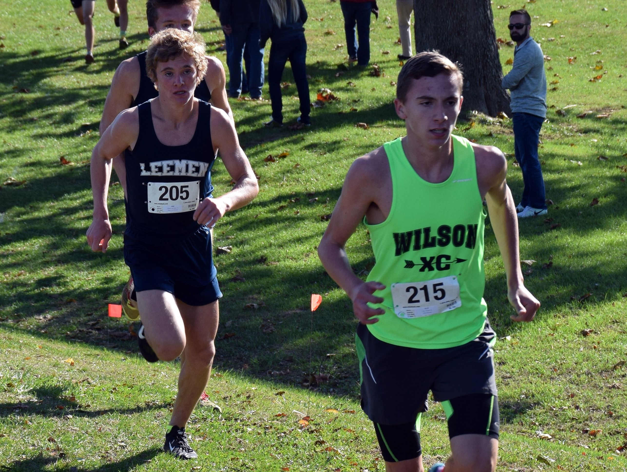 Wilson Memorial's Vincent Leo, right, leads Robert E. Lee's Oliver Wilson-Cook, center, and Jacob Warner at the mile mark of the boys race at the Conference 36 cross country championship at Wilson Workforce & Rehabilitation Center in Fishersville, Va., on Wednesday, Oct., 26, 2016.