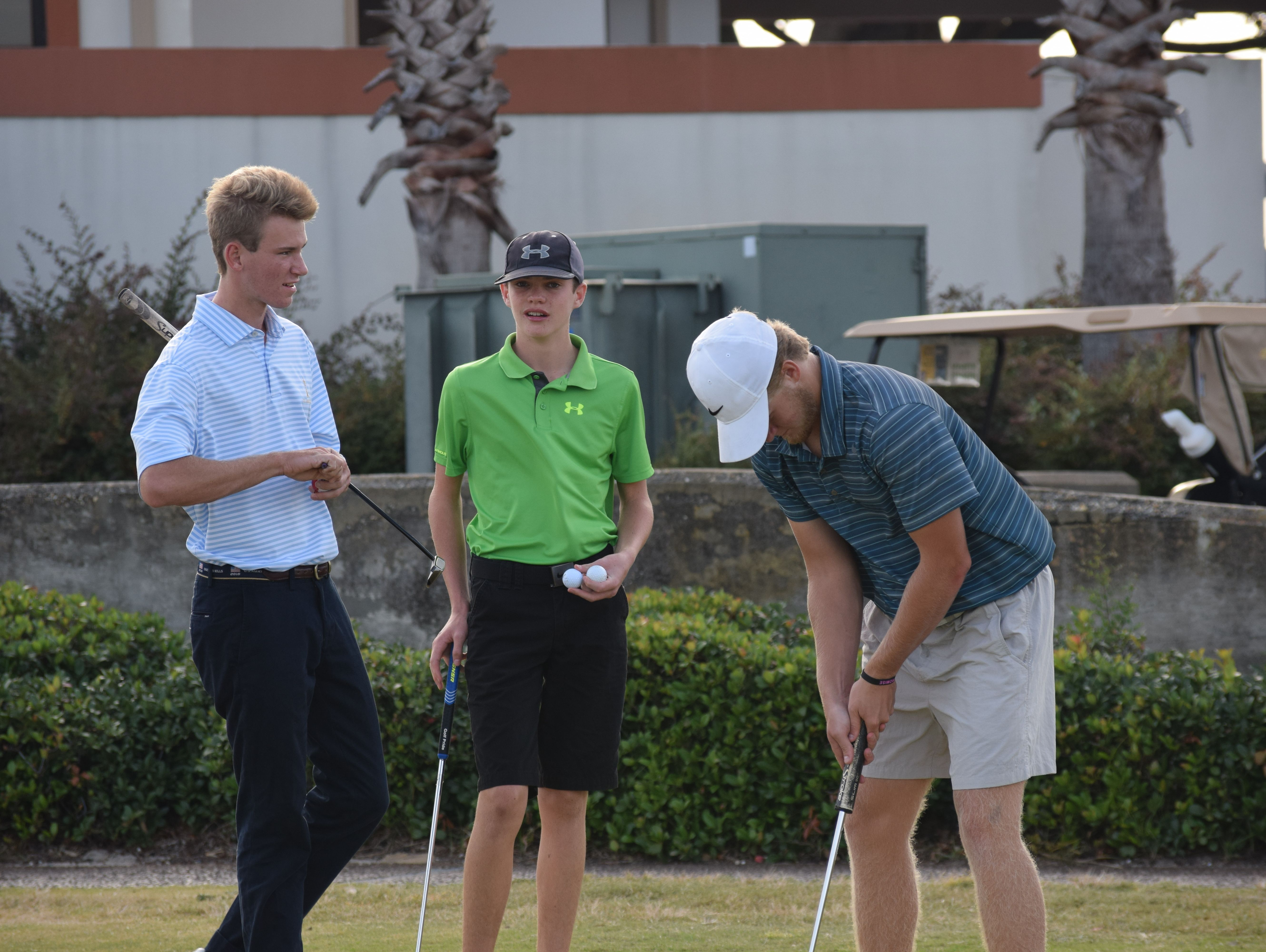 Gulf Breeze High players Brian Richards, Luke Ellis and RJ Phillips practice Wednesday at Tiger Point in preparation for Monday's Class 2A State Tournament where they will be among four area teams in boys and girls classifications participating in the state level.