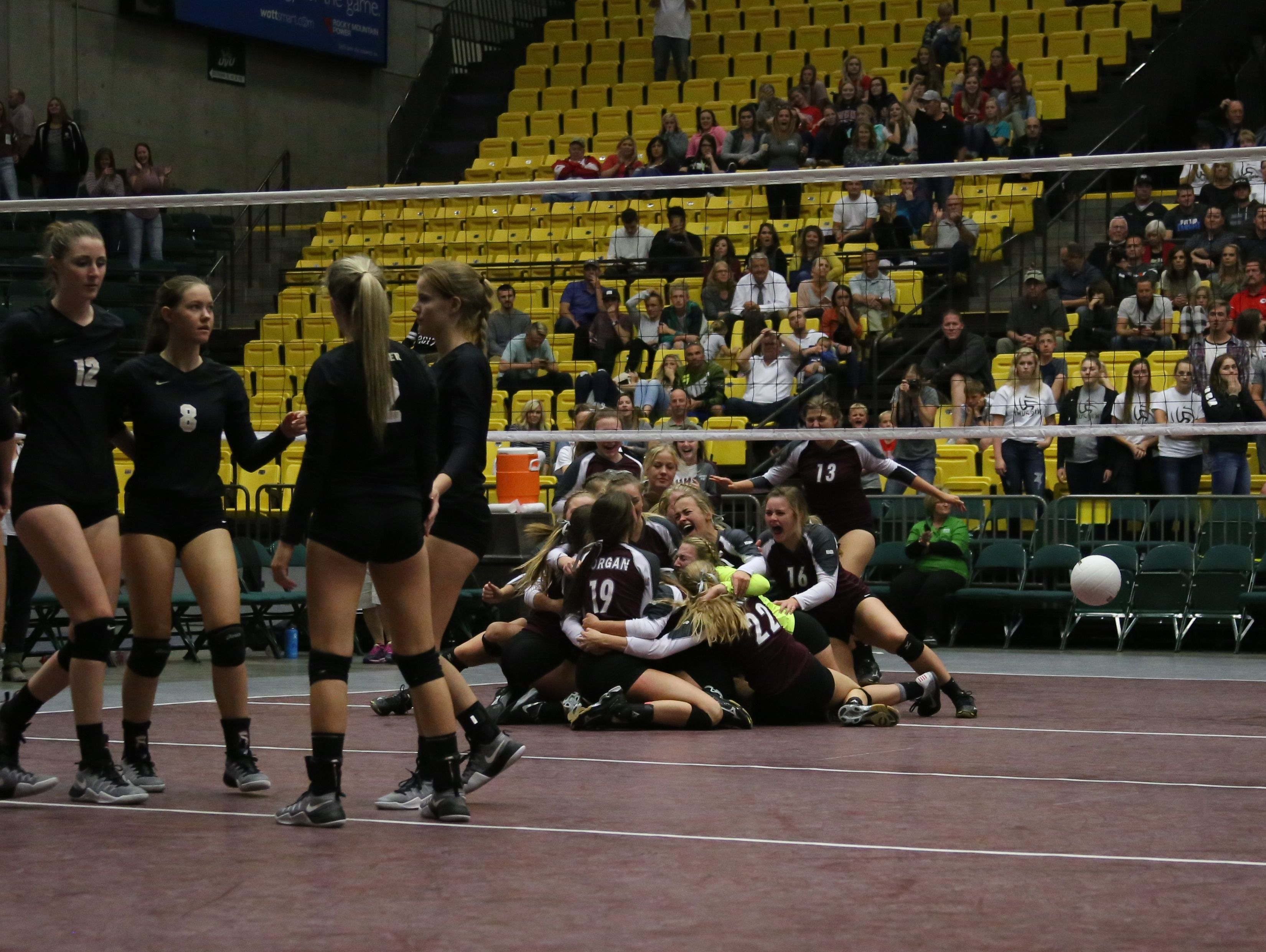 Morgan celebrates its 3A volleyball state title at Utah Valley University Thursday, October 27, 2016.