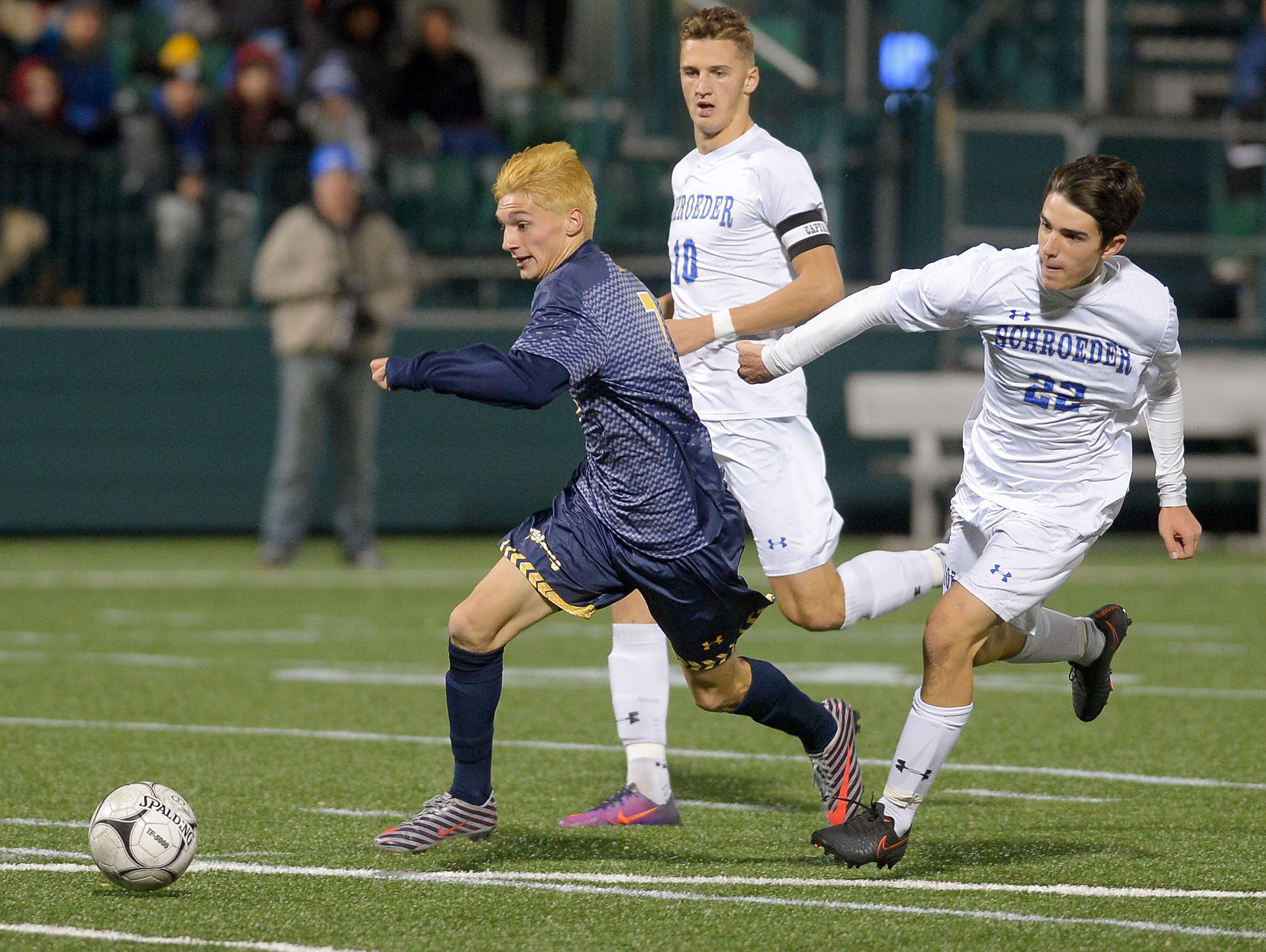 Webster Thomas' Ryan Cullen, left, breaks away from Webster Schroeder's Andriy Demydiv and Conor Bollin to score the Titans' first half goal during a Class AA semifinal played at Rhinos Stadium on Oct. 27, 2016.