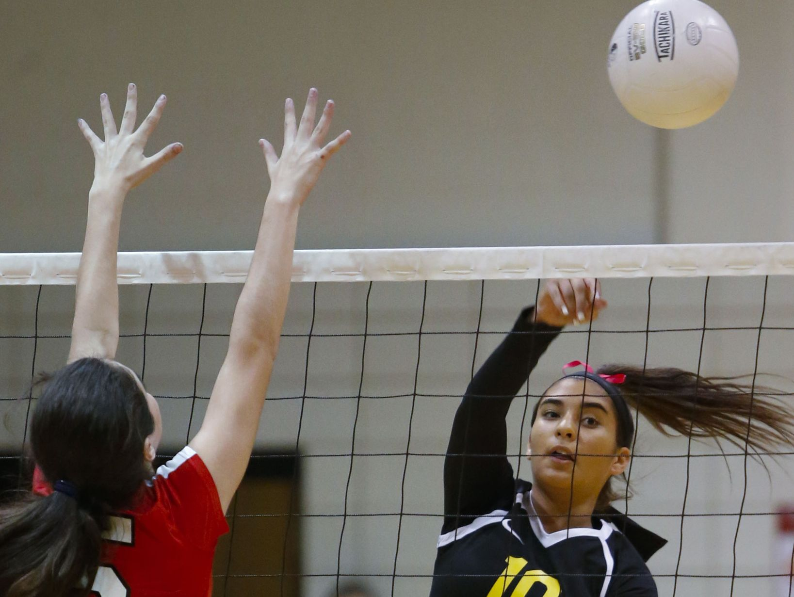 Padua's Taylor Valletti (10) chips the ball past Ursuline's Kylie Nocket in the first game of Padua's five set win against Ursuline Thursday.