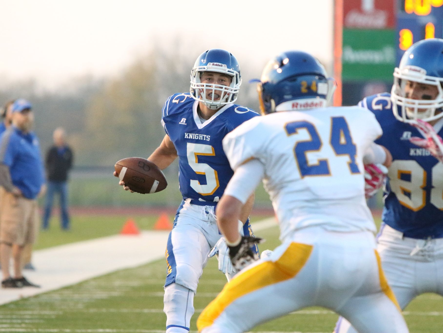 Hunter Thompson (5) of O'Gorman runs behind the block of Brett Sehr (88) during Thursday's game against Aberdeen Central in Sioux Falls.