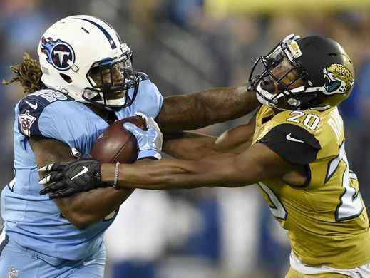 Titans running back Derrick Henry (22) stiff-arms Jaguars cornerback Jalen Ramsey (20) in the first half of Thursday night's game at Nissan Stadium.