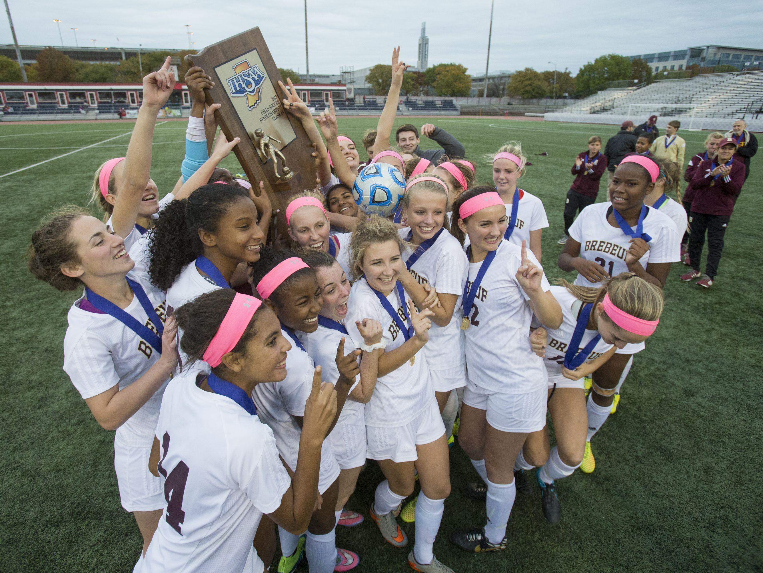 Brebeuf Jesuit celebrates their IHSAA Girls Class 2A State Soccer Finals win at, Carroll Stadium, Oct. 31, 2015. Brebeuf beat Penn, 2-1.