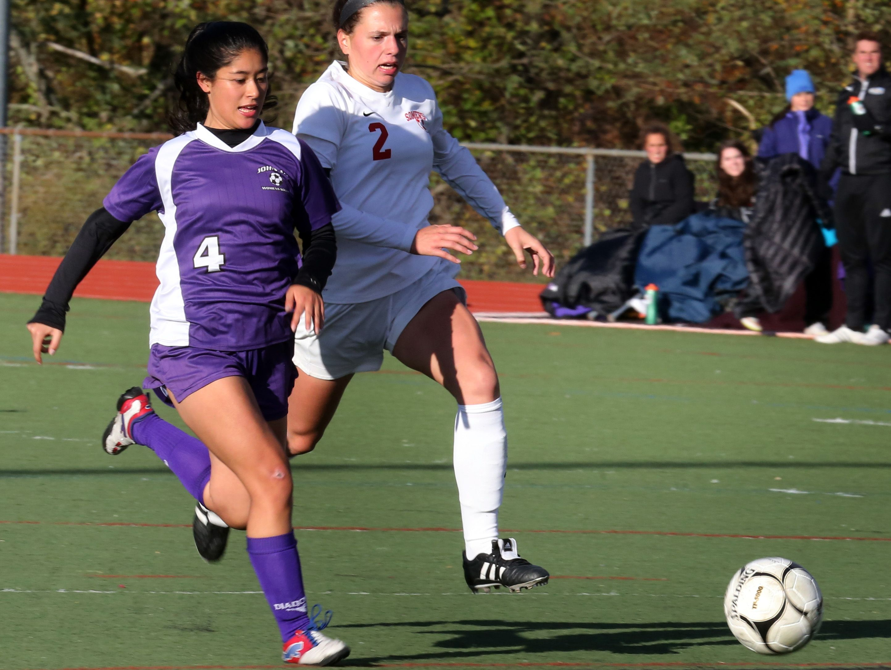 Somers Jenna Menta (2) and John Jay's Katrina Weiner (4) battles for control of the ball during Section 1 Class A girls soccer semifinal at Somers High School on Oct. 28, 2016. Somers defeats John Jay Cross River 4-2.