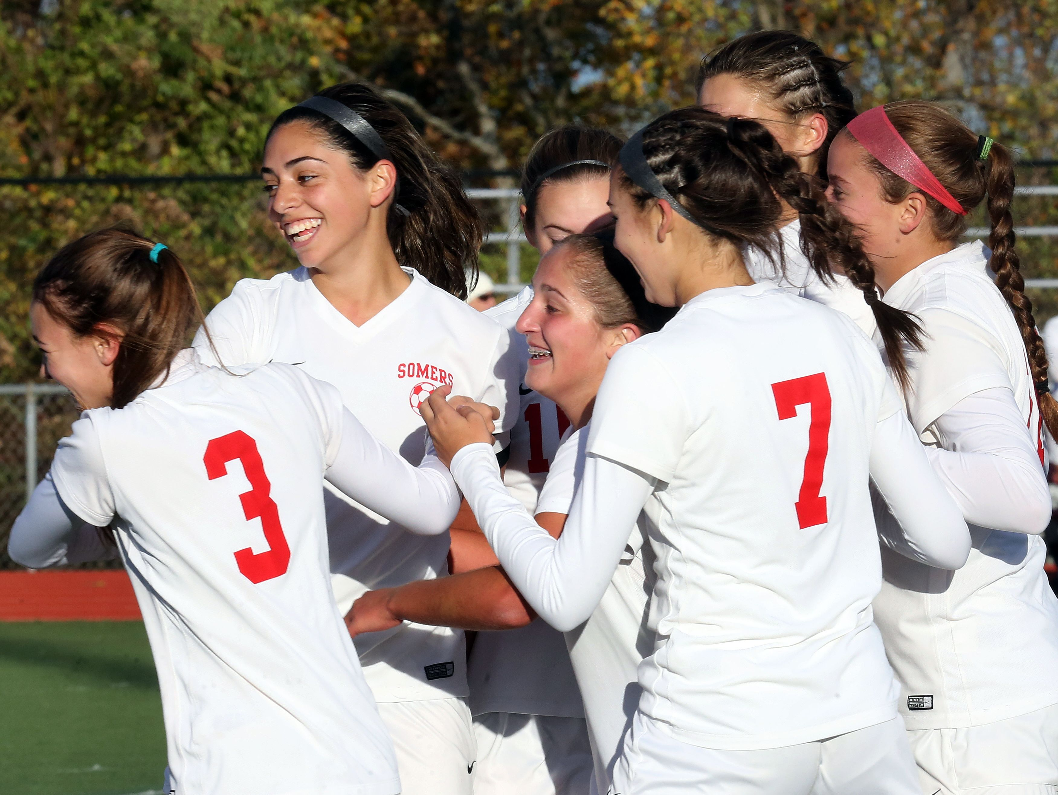 Somers Ciara Ostrander (4) celebrates scoring with her teammates during Section 1 Class A girls soccer semifinal at Somers High School on Oct. 28, 2016. Somers defeats John Jay Cross River 4-2.