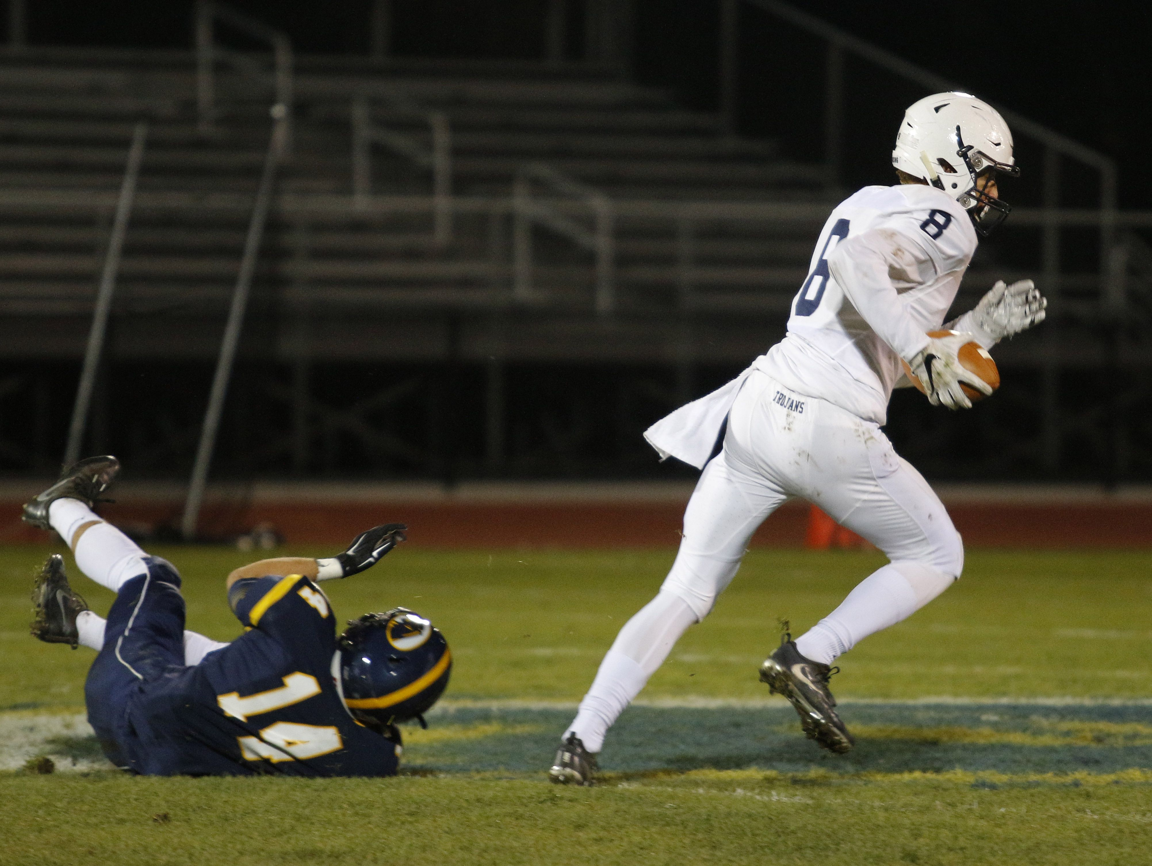East Lansing's Blake Underwood, right, escapes from DeWitt's Alan Smith (14) on a long touchdown reception Friday, Oct. 28, 2016, in DeWitt, Mich.
