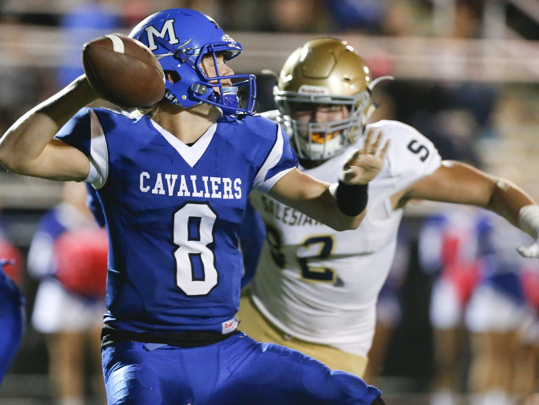 Middletown quarterback Drew Fry, seen here against Salesianum, Sophomore quarterback Drew Fry threw for three touchdowns and ran for one in the CAvaliers' 48-8 win over Appoquinimink on Friday.