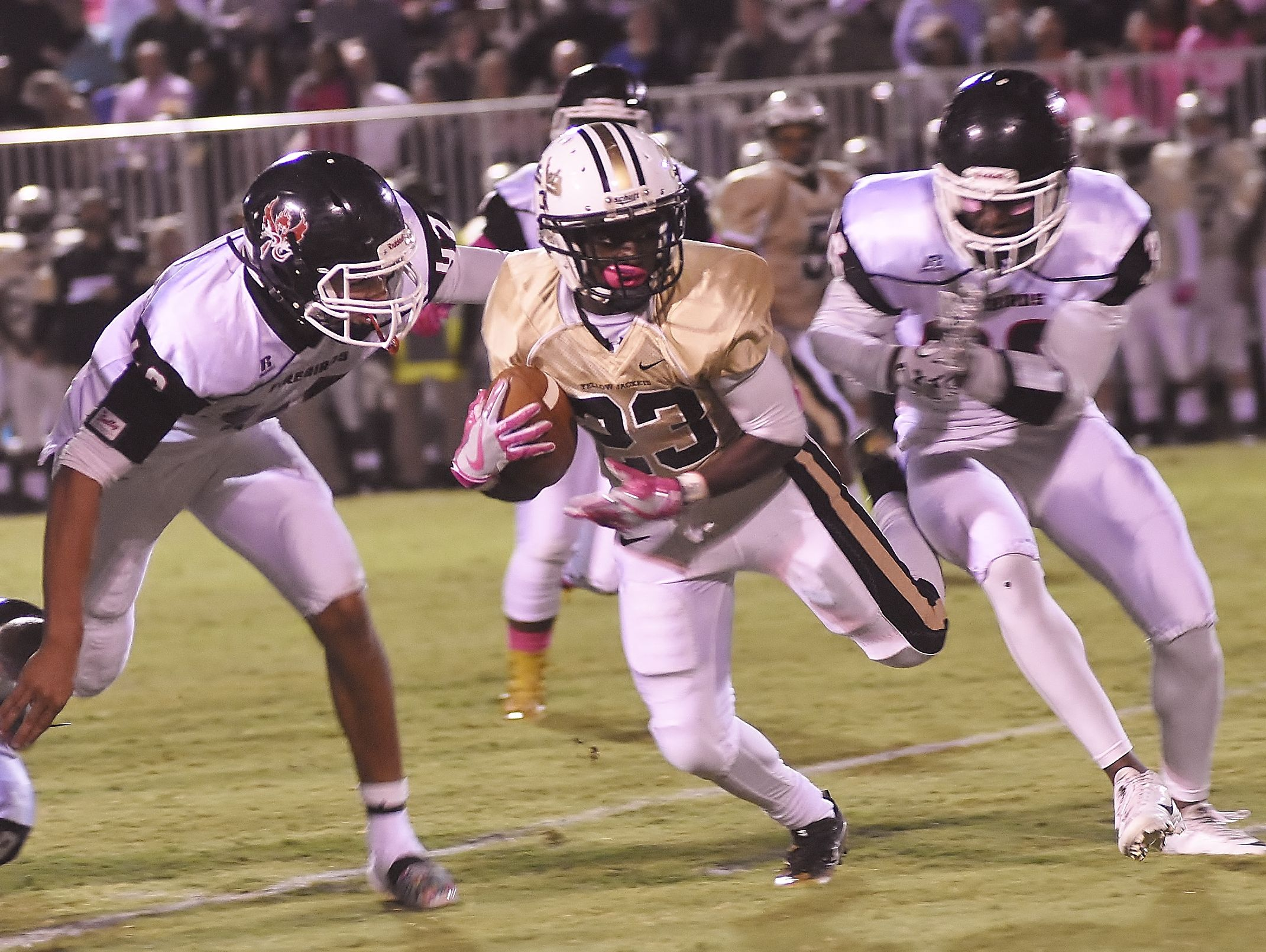 Dayron Johnson weaves between defenders Friday night.