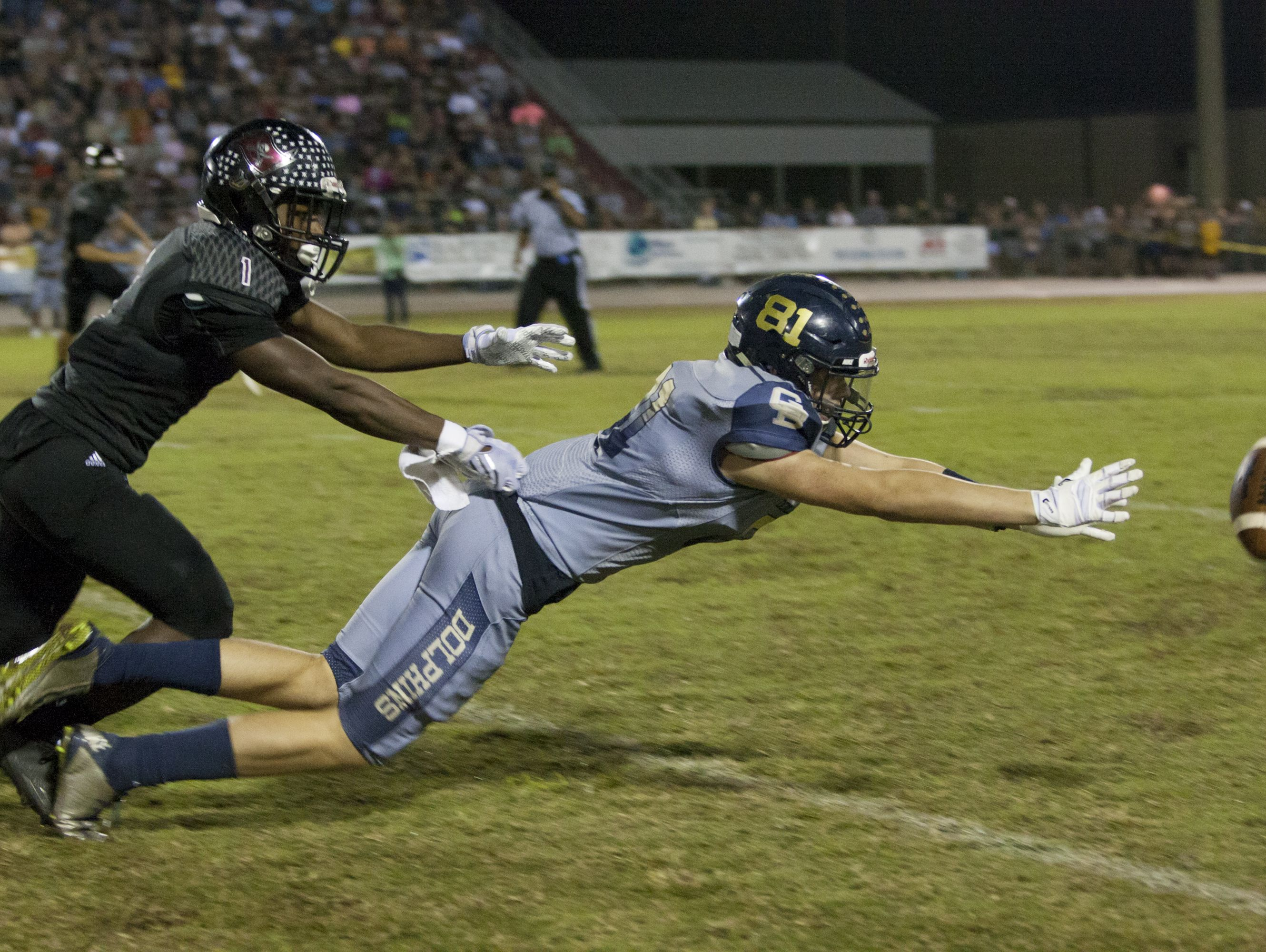 The pass is beyond the reach of Bryce Callahan (81) during the Gulf Breeze vs Navarre football at Navarre High School on Friday, October 8, 2016.