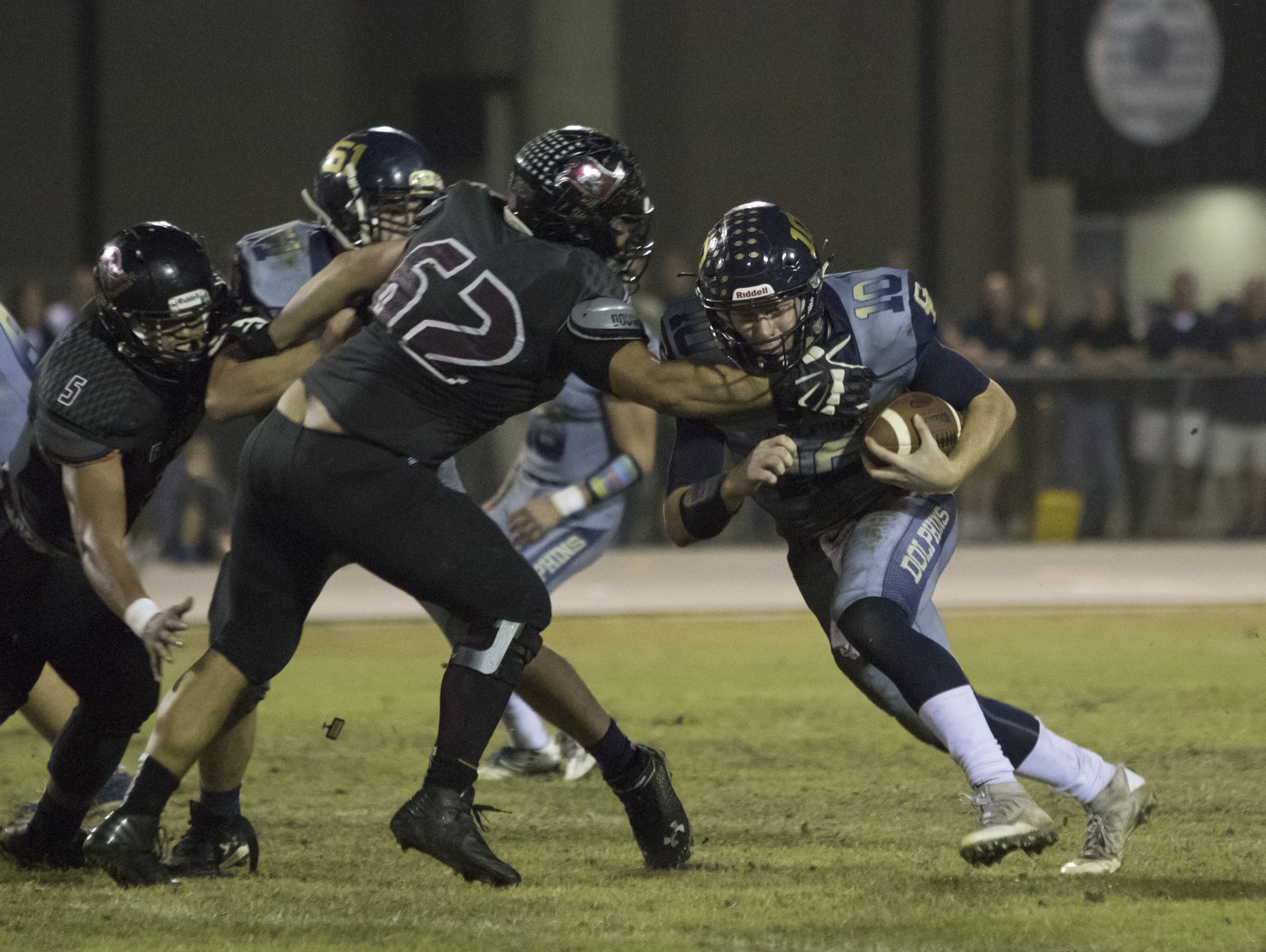 Quaterback Tyler Phelps (10) carries the ball during the Gulf Breeze vs Navarre football at Navarre High School on Friday, October 8, 2016.