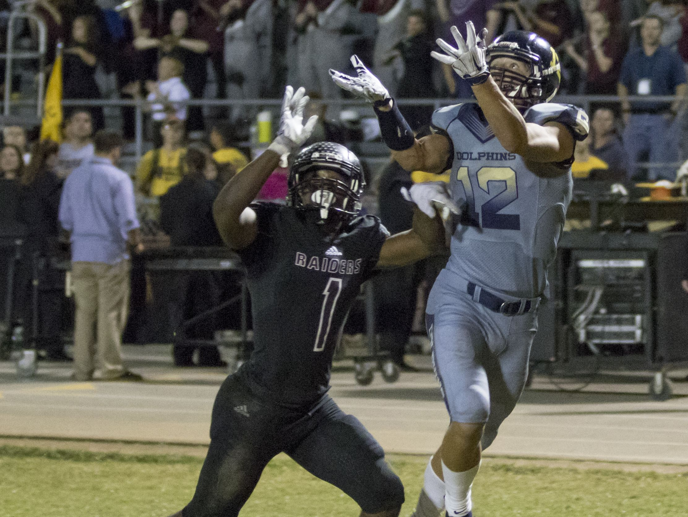 Cole Sheppard (12) catches the ball for a touchdown during the Gulf Breeze vs Navarre football at Navarre High School on Friday, October 8, 2016.