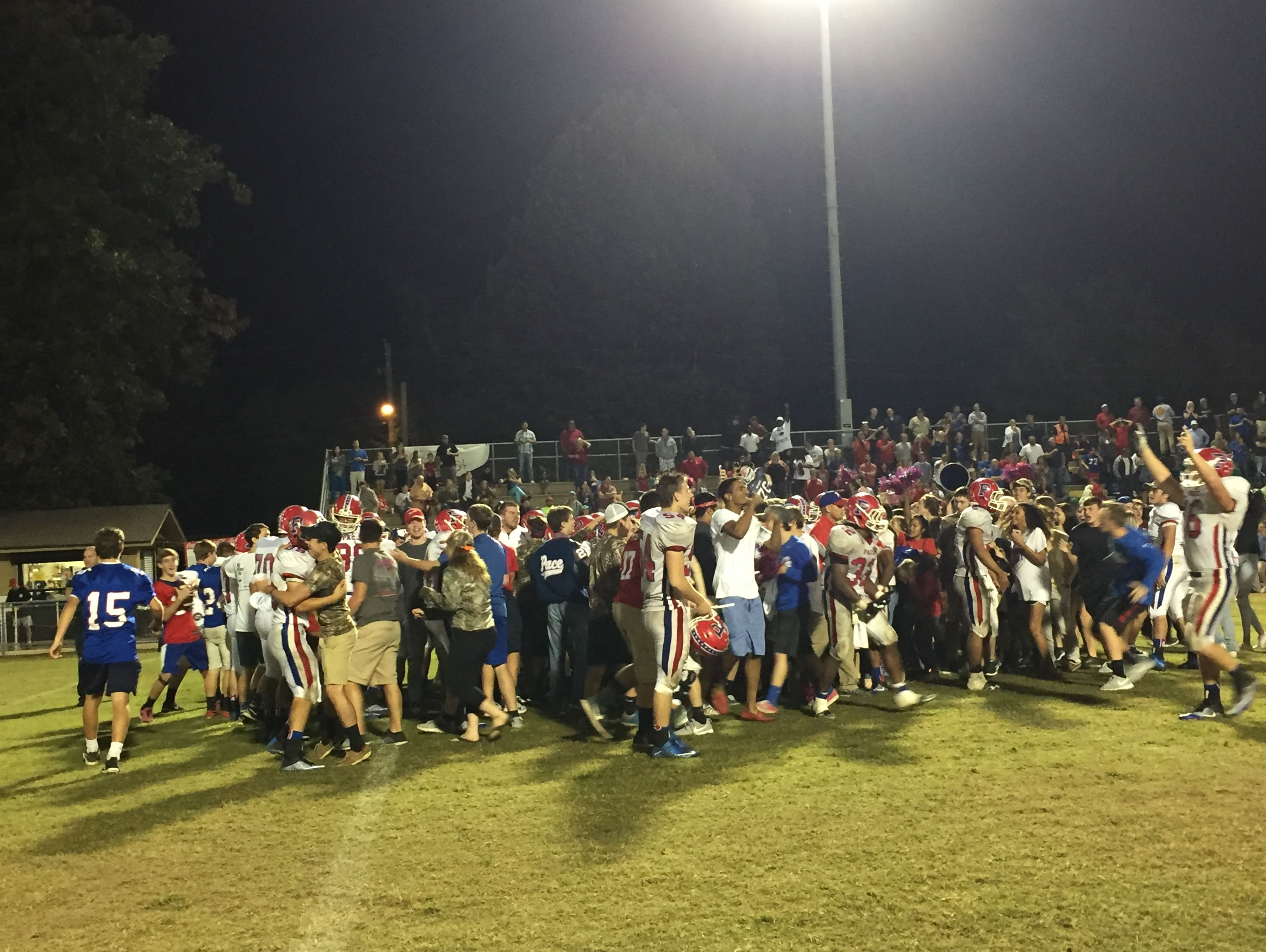 Pace players and fans celebrate after a 35-34 overtime victory Friday at Milton.