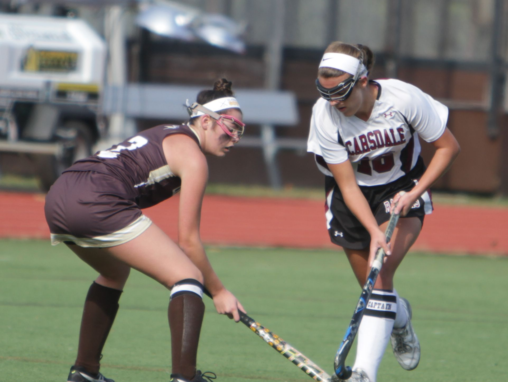 Scarsdale's Erin Nicholas (right) stickhandles past Colleen Geyer during a Section 1, Class A field hockey semifinal game between Scarsdale and Clarkstown South at Scarsdale High School on Saturday, Oct. 29, 2016. Scarsdale won 7-1.
