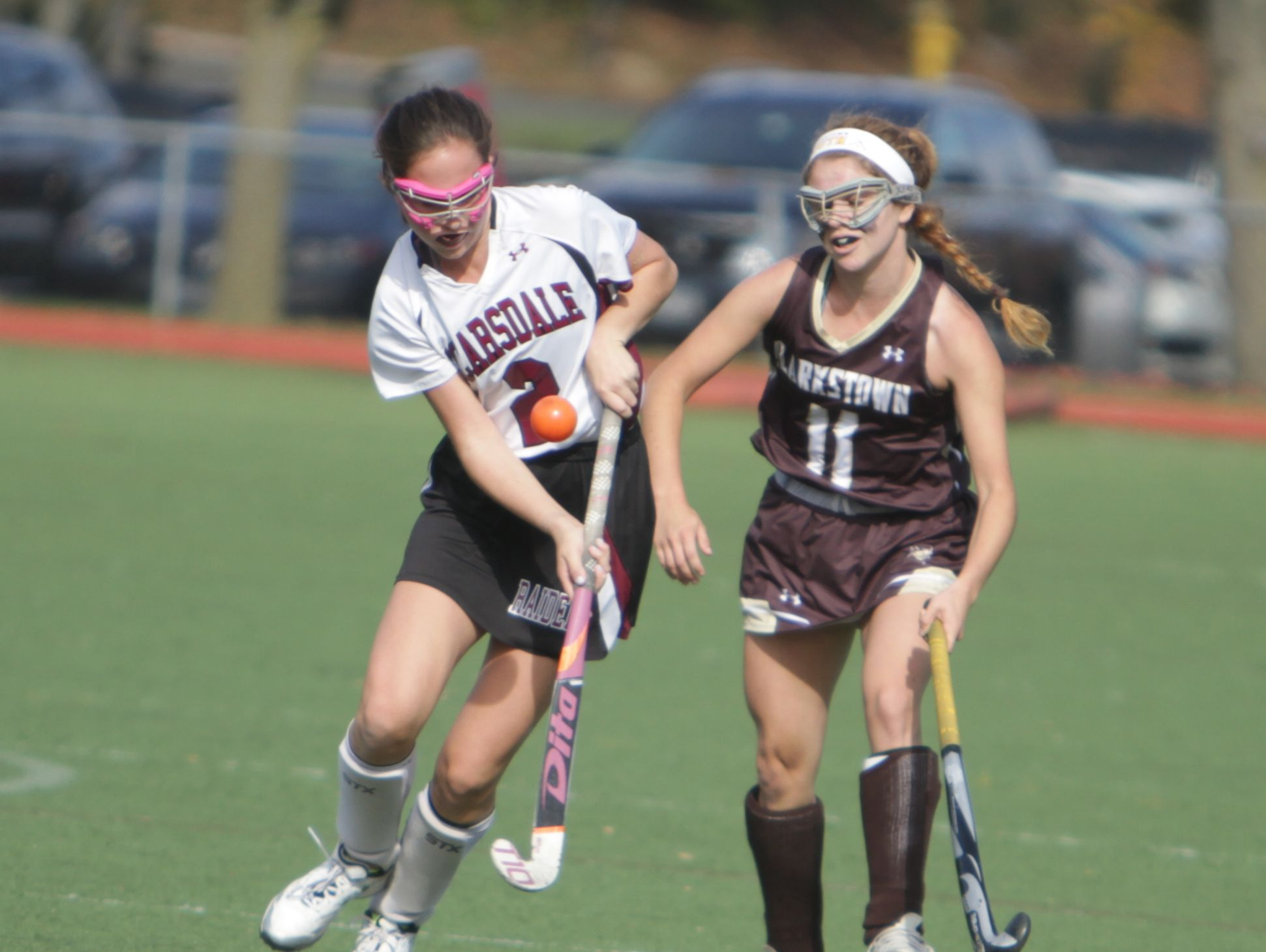 Scarsdale's Elizabeth Scarcella (left) and Clarkstown South's Dara Studnitzer battle for possession during a Section 1, Class A field hockey semifinal game between Scarsdale and Clarkstown South at Scarsdale High School on Saturday, Oct. 29, 2016. Scarsdale won 7-1.