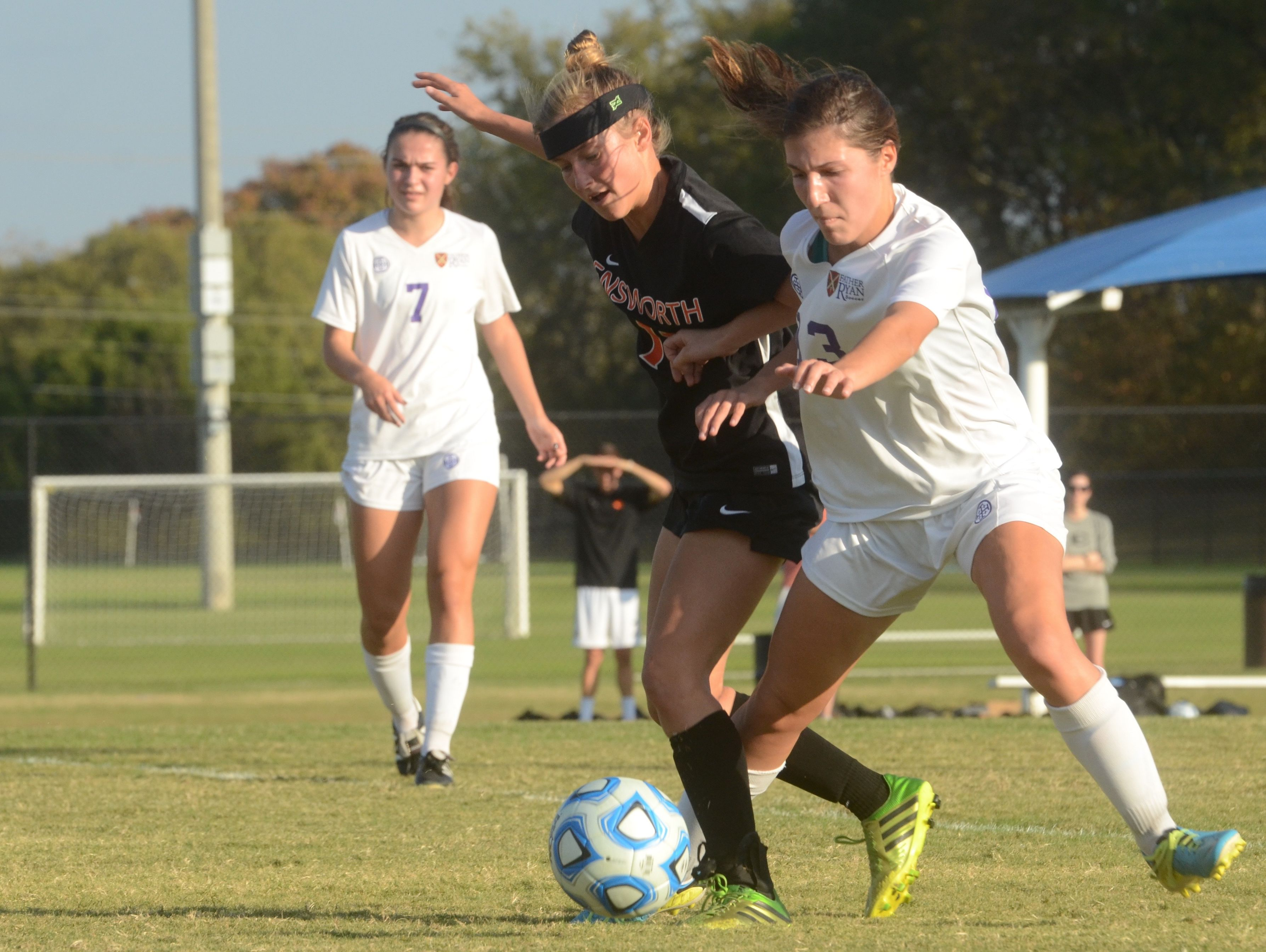 Ensworth's Dorothy Faber and Father Ryan's Olivia Allen (3) battle for possession as Father Ryan's Kelsey Roche (7) looks on during Saturday's Division II-AA title match.