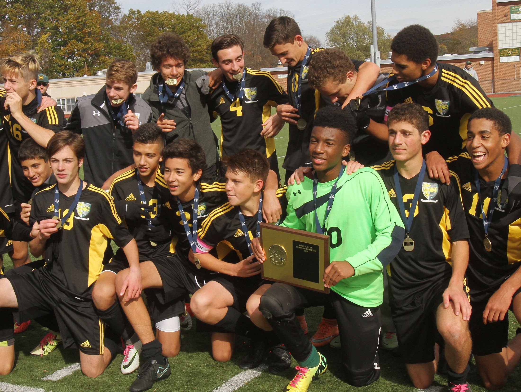 Hastings players celebrate with the Section 1 plaque after defeating Rye Neck 1-0 in the boys soccer Section 1 Class B championship game at Lakeland High School in Shrub Oak High School Oct. 29, 2016. Hastings won the game 1-0.