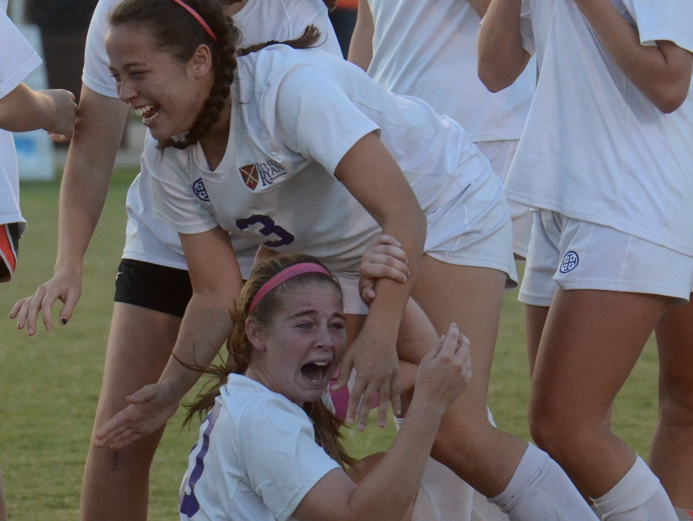 Olivia Allen (3) and Tally Bishop (10) celebrate after Father Ryan's 1-0 championship win over Ensworth.