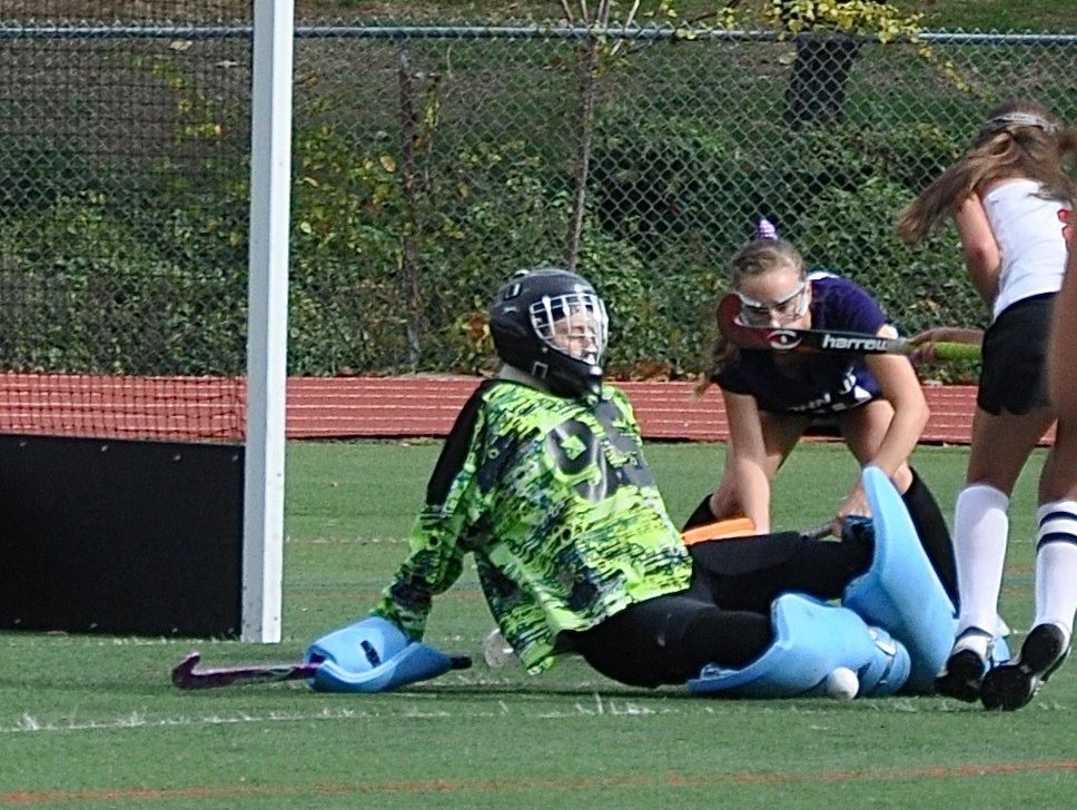 John Jay's Haley Martinsen makes sliding save in first half. Photo from Oct 29, 2016;