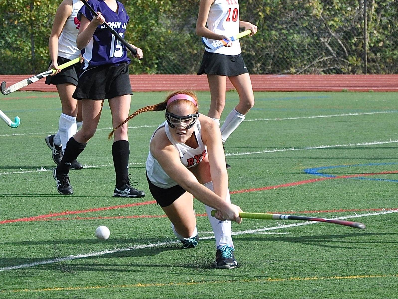 Rye's Taylor Volpe gets low to drive ball out of trouble.