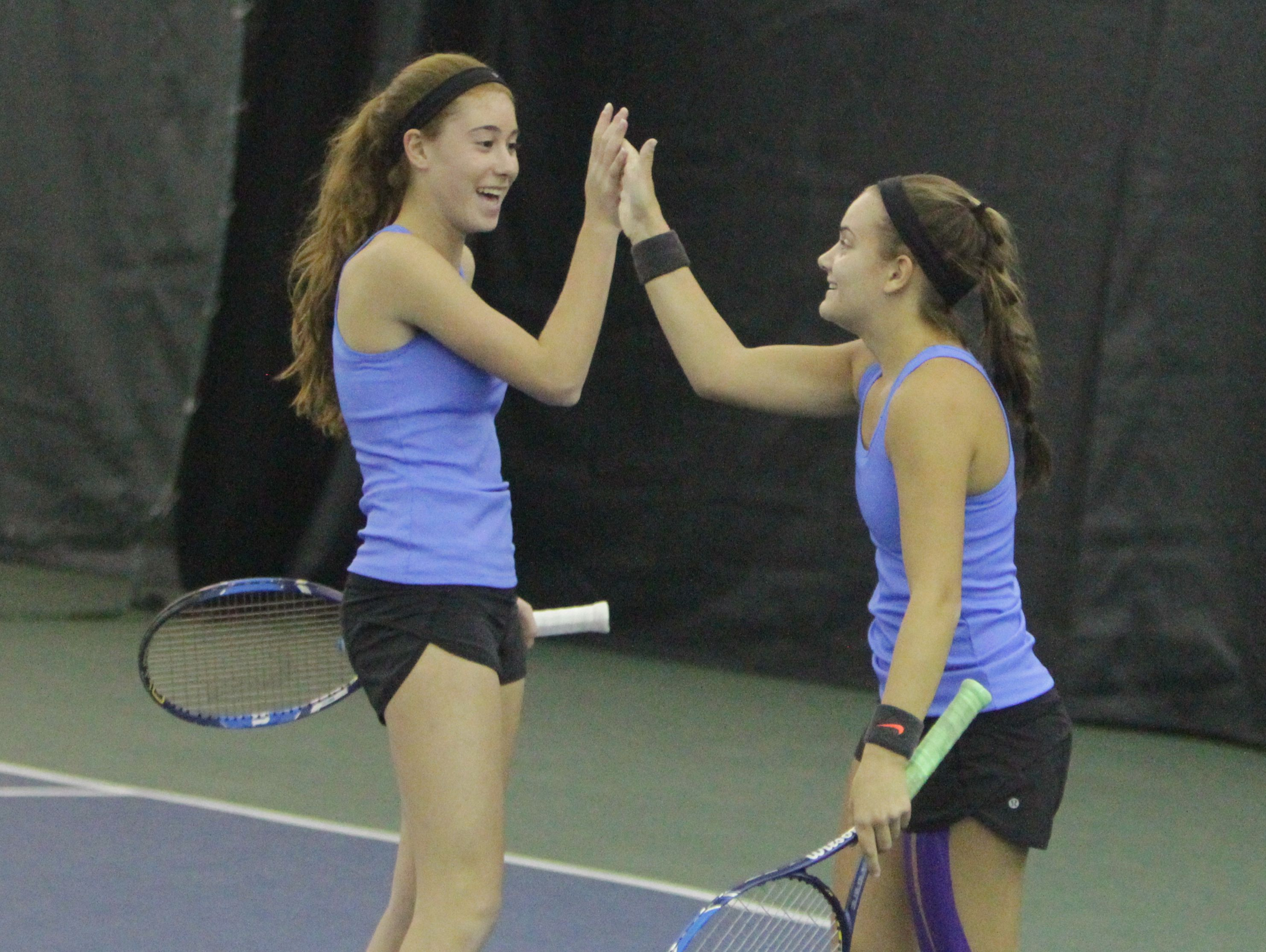 Ursuline's Vanessa Ciano (left) and Laina Campos celebrate after winning a point during a quarterfinal match at the New York State girls tennis tournament at Sound Shore Indoor Tennis in Port Chester on Sunday, Oct. 30th, 2016.