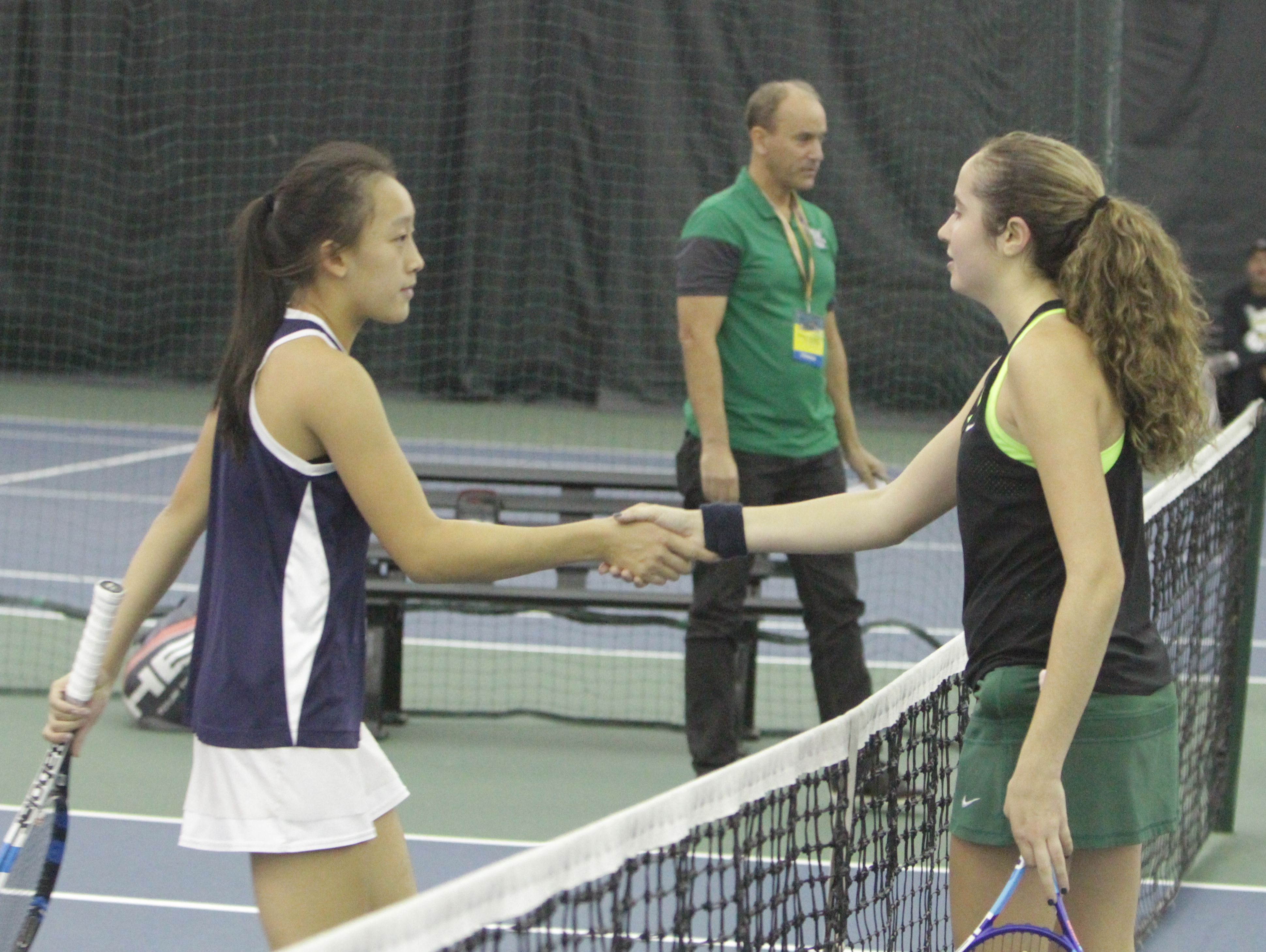 Briarcliff's Rebecca Lim (left) and Yorktown's Caitlin Ferrante shake hands after a quarterfinal match at the New York State girls tennis tournament at Sound Shore Indoor Tennis in Port Chester on Sunday, Oct. 30th, 2016. Ferrante won the match.