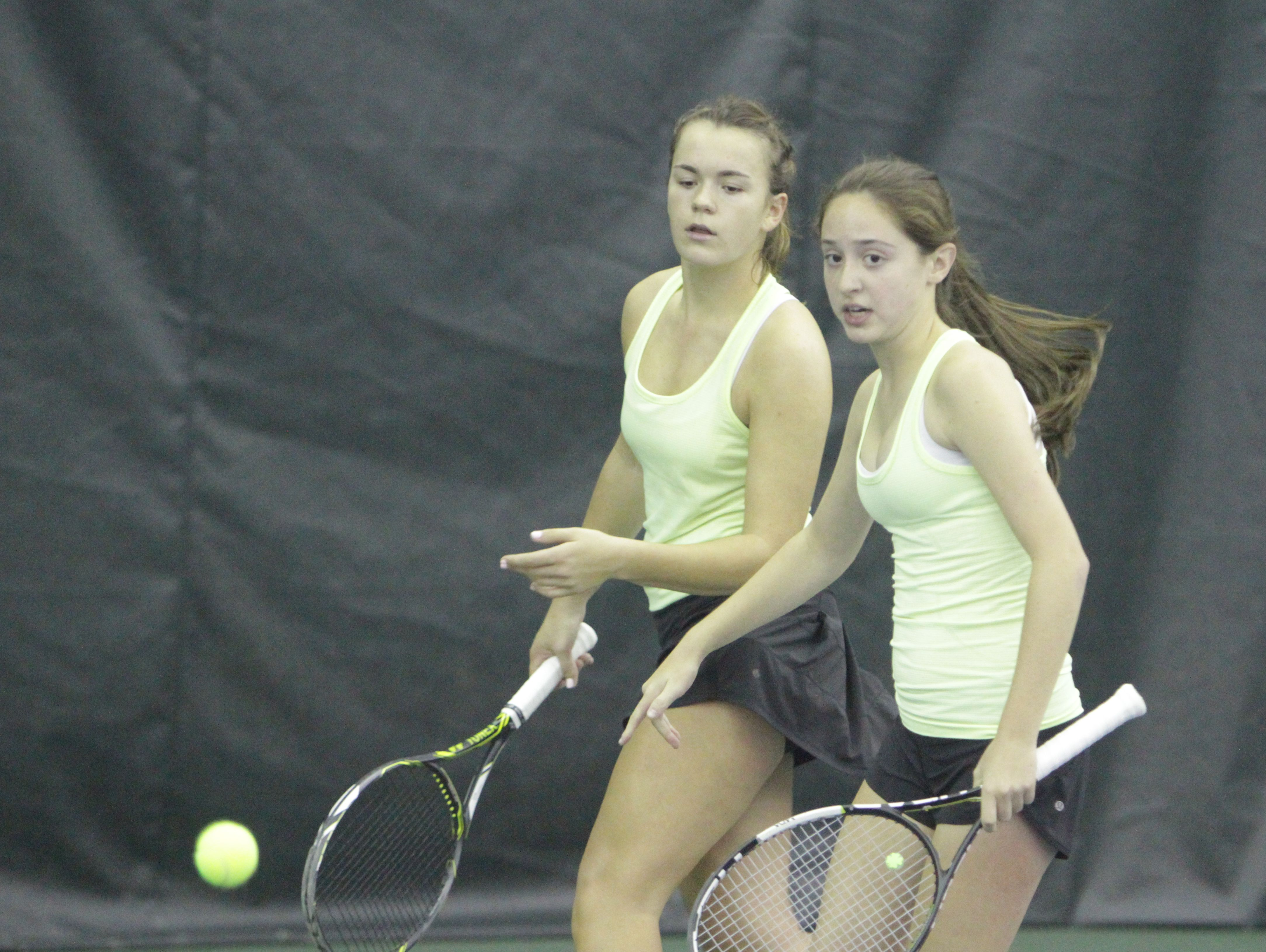 Clarkstown North's Martyna Czarnik (left) and Sydney Miller between points during a quarterfinal match at the New York State girls tennis tournament at Sound Shore Indoor Tennis in Port Chester on Sunday, Oct. 30th, 2016.