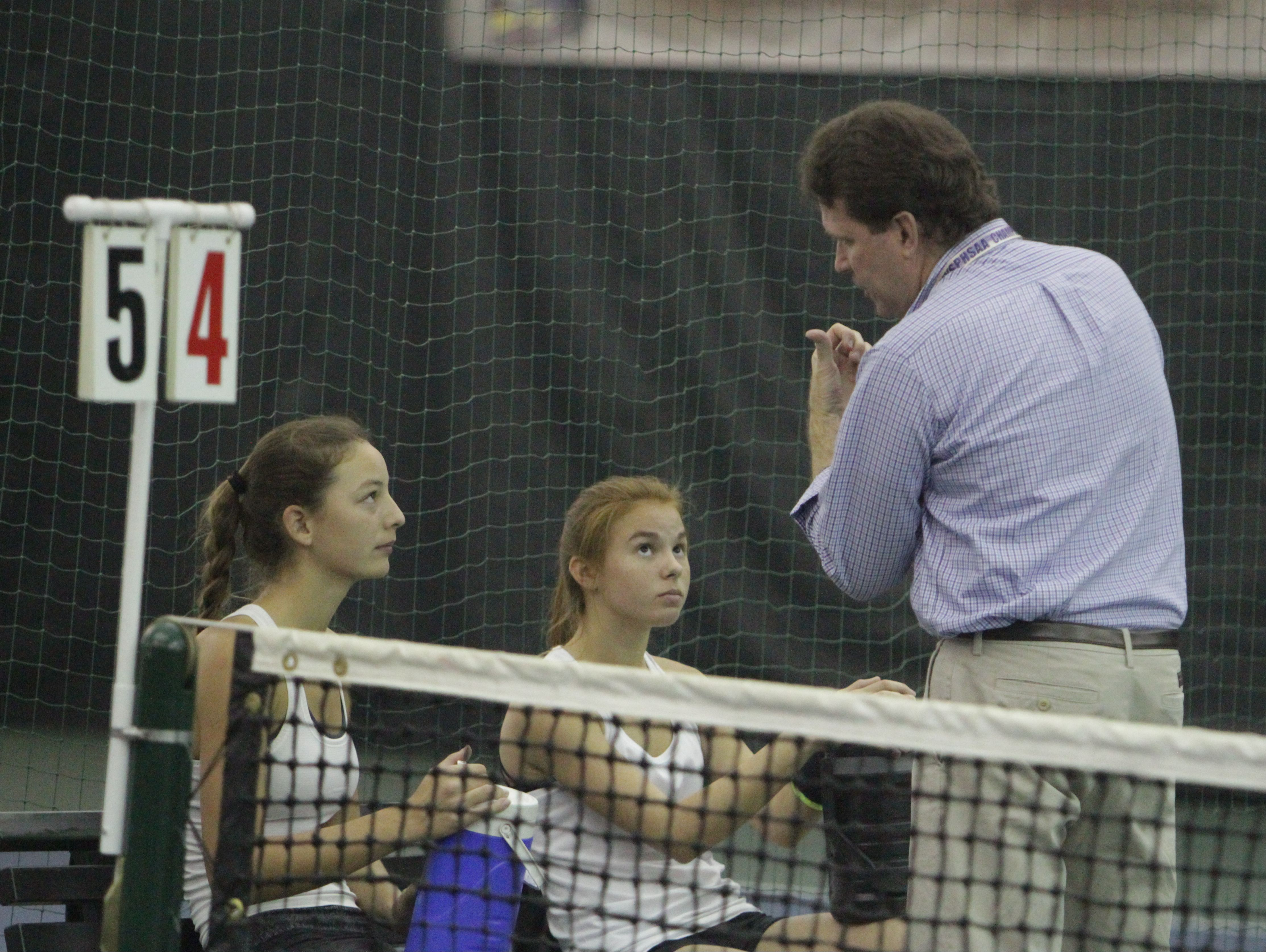 Mamaroneck's Katherine Orgielewicz (left) and Juliette Nask talk with coach Tim Hooker during a quarterfinal match at the New York State girls tennis tournament at Sound Shore Indoor Tennis in Port Chester on Sunday, Oct. 30th, 2016.
