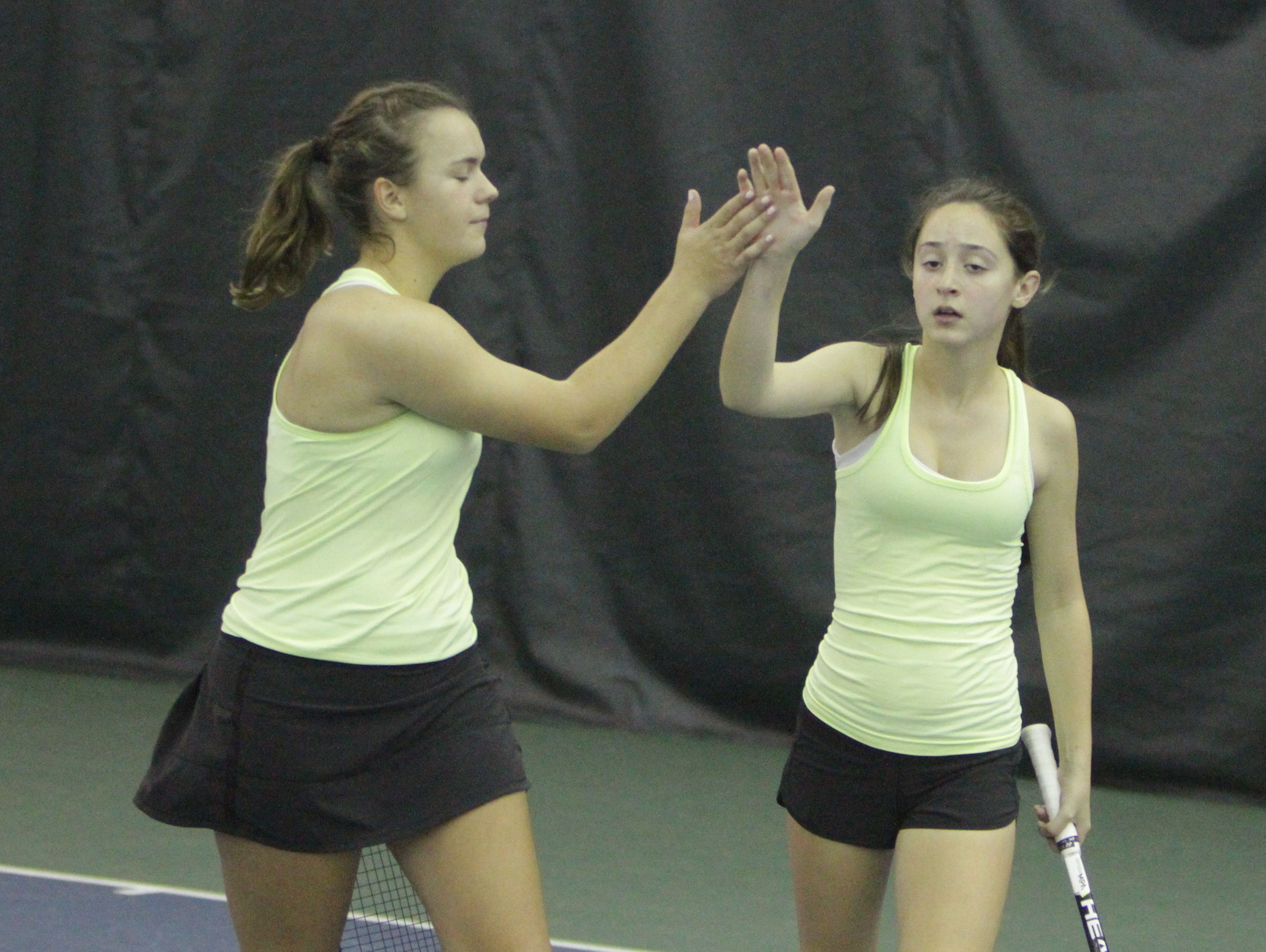 Clarkstown North's Martyna Czarnik (left) and Sydney Miller celebrate after winning a quarterfinal match at the New York State girls tennis tournament at Sound Shore Indoor Tennis in Port Chester on Sunday, Oct. 30th, 2016.