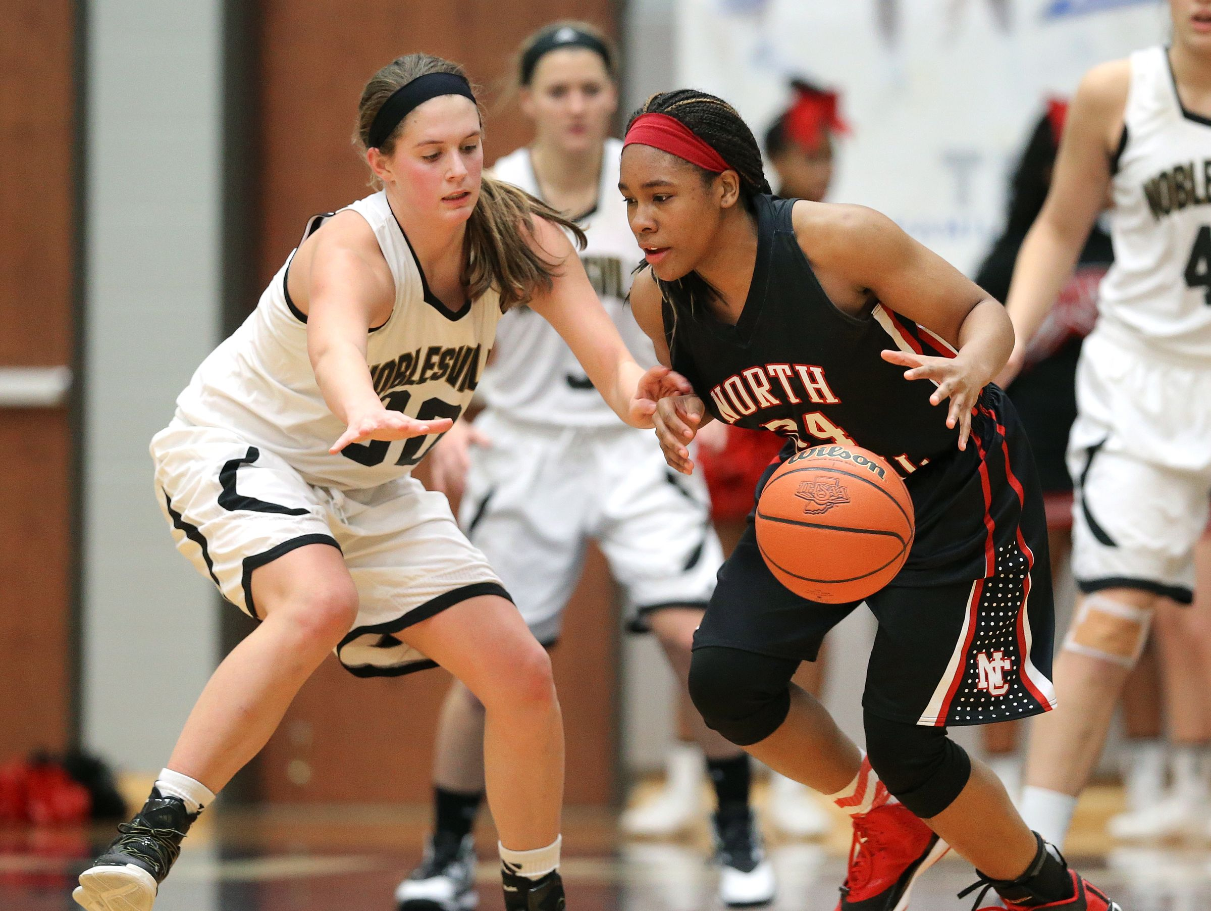 FILE – North Central's Ajanae' Thomas and Noblesville's Emily Kiser battle for a loose ball.
