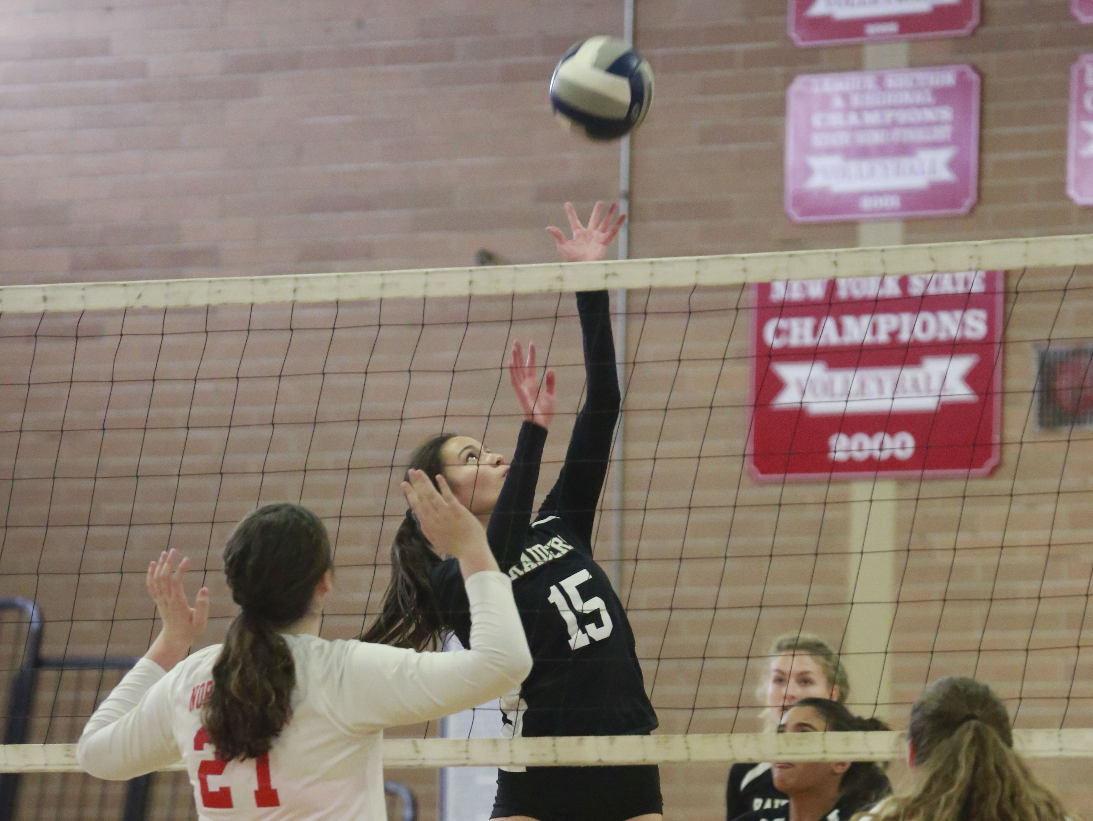 Scarsdale's volleyball player Annemarie Horn (15) returns the ball against North Rockland at North Rockland High School in Thiells on Oct. 31, 2016.
